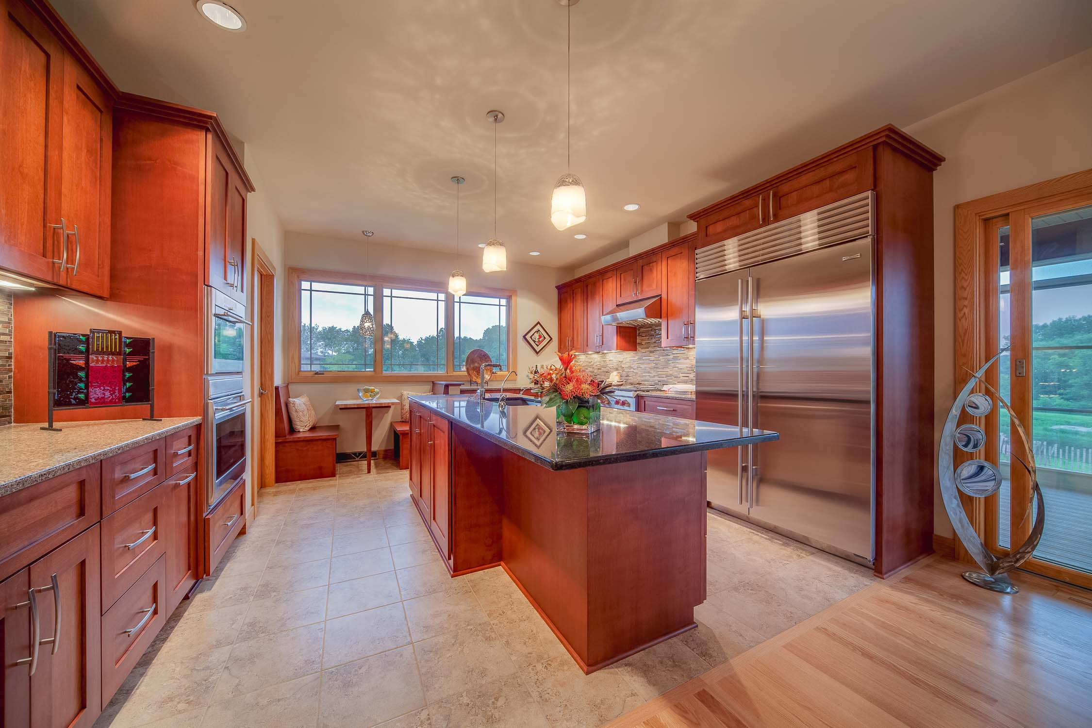 - This kitchen uses halogen lamps with Alzak reflective trims to disperse light throughout the kitchen. Pendants add a decorative shadow to the ceiling.