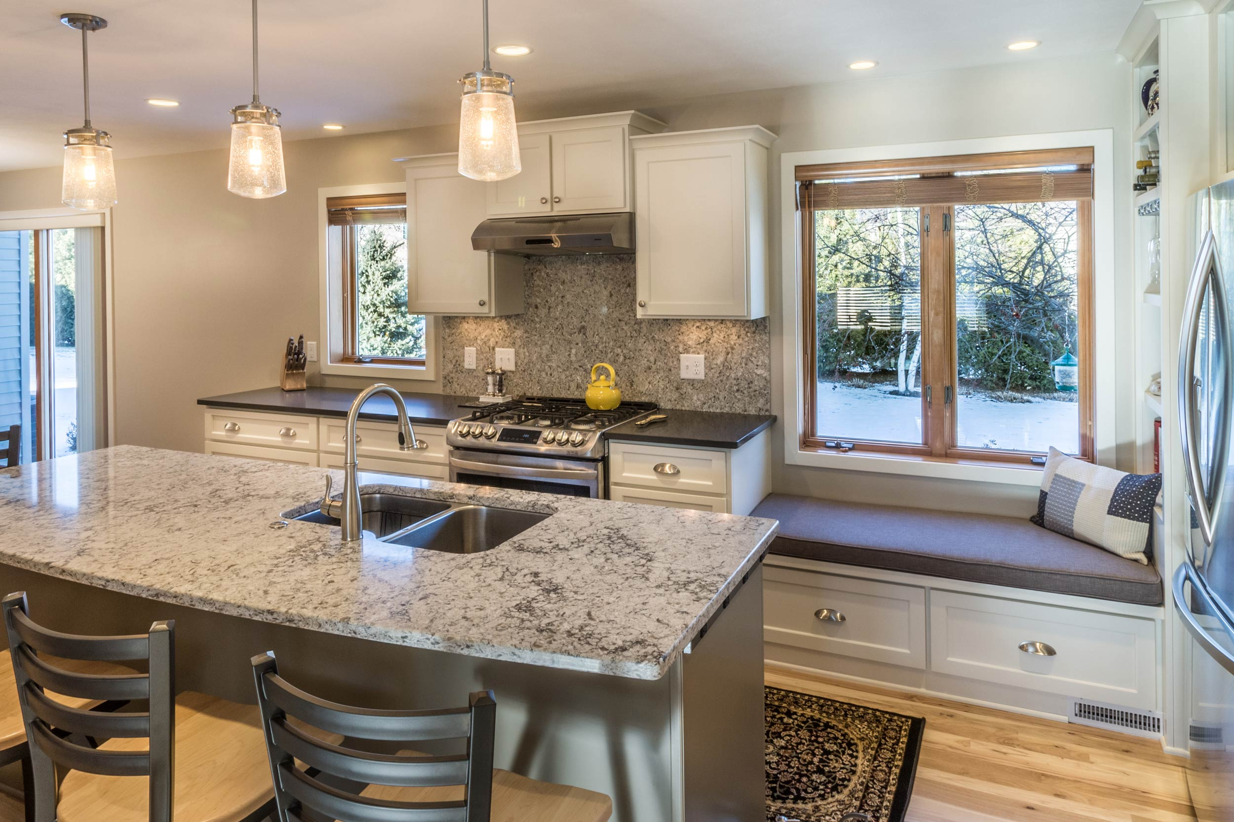 - Himalayan Moon quartz by Caesarstone was used for both the island and backsplash of this kitchen.