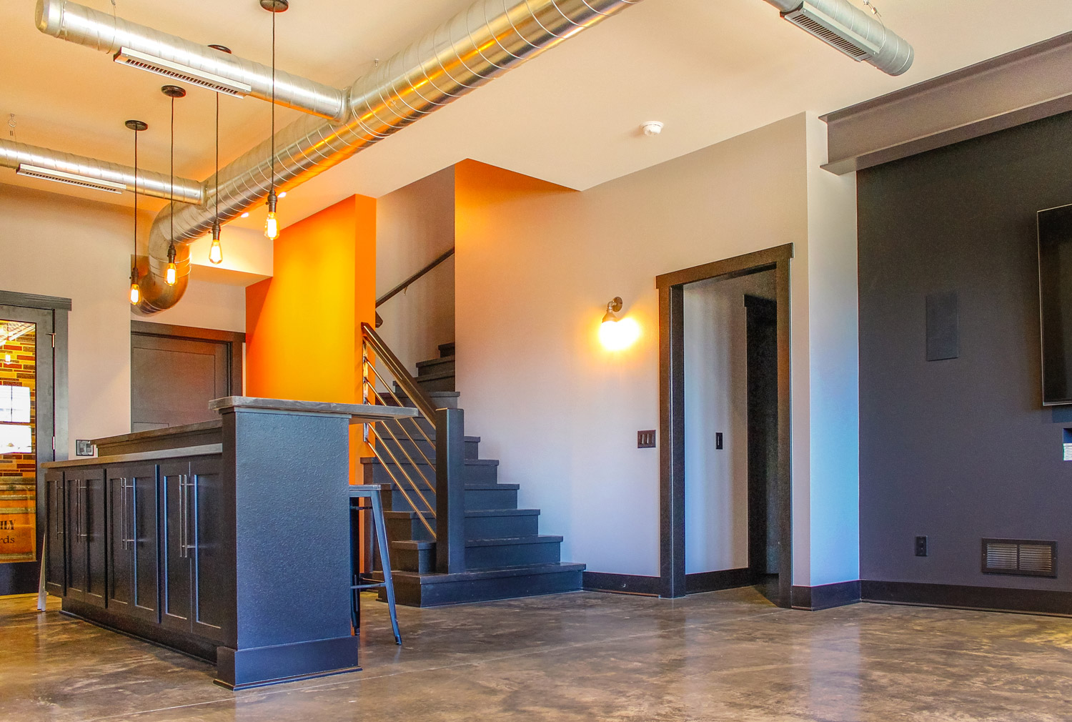 - A contemporary finished lower level design transformed this basement into an industrial chic space.
