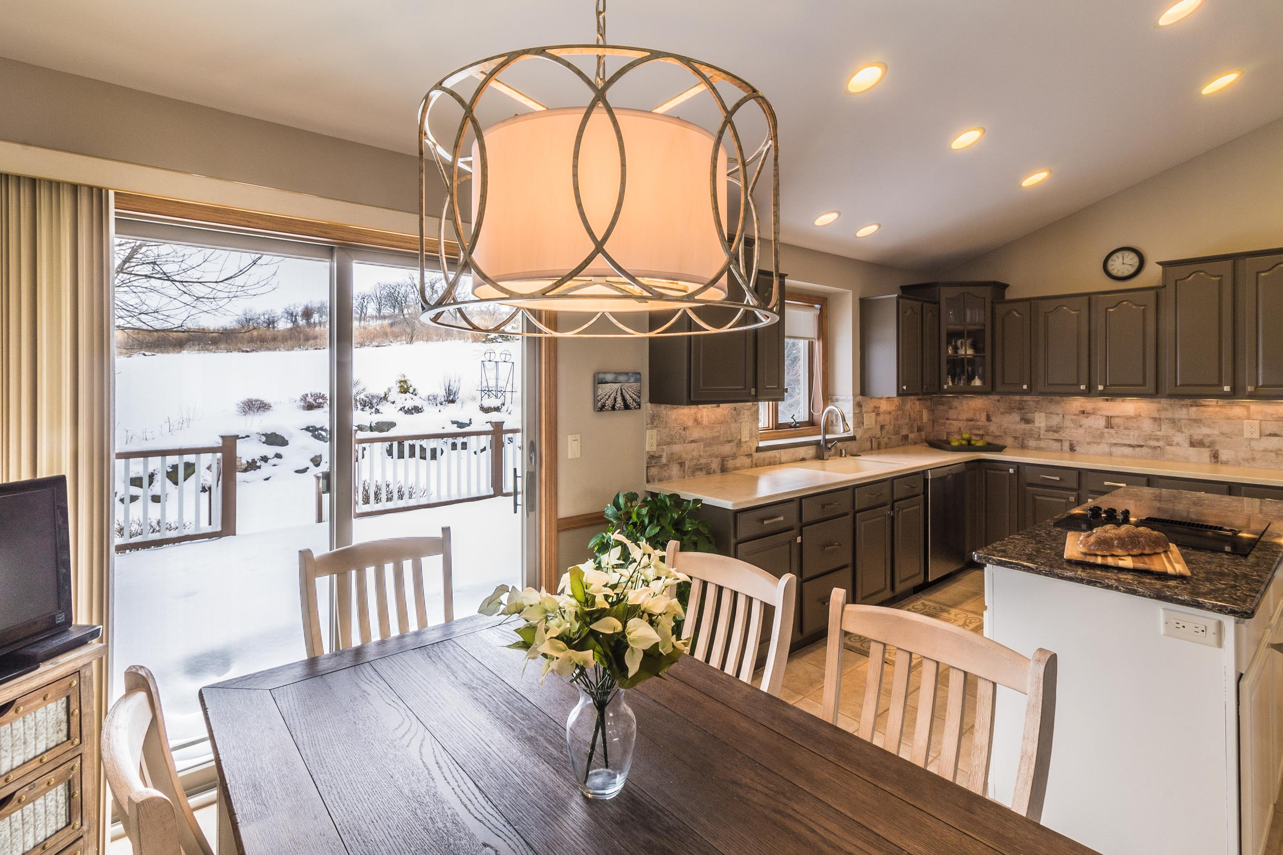 - This semi-open kitchen has an island and dinette, with openings to the foyer, stairway, and formal dining room. It has an audible connection to the adjacent living room, but is visually separated.
