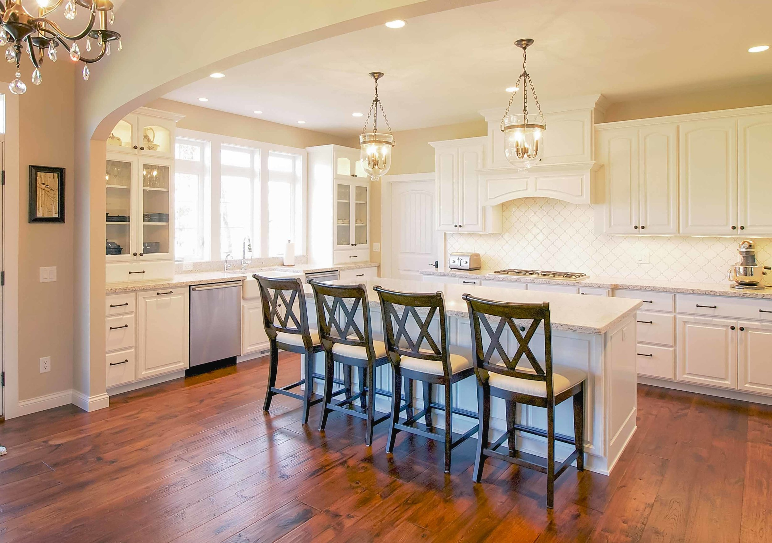 - The quiet, properly sized range hood in this kitchen is fully concealed in cabinetry.