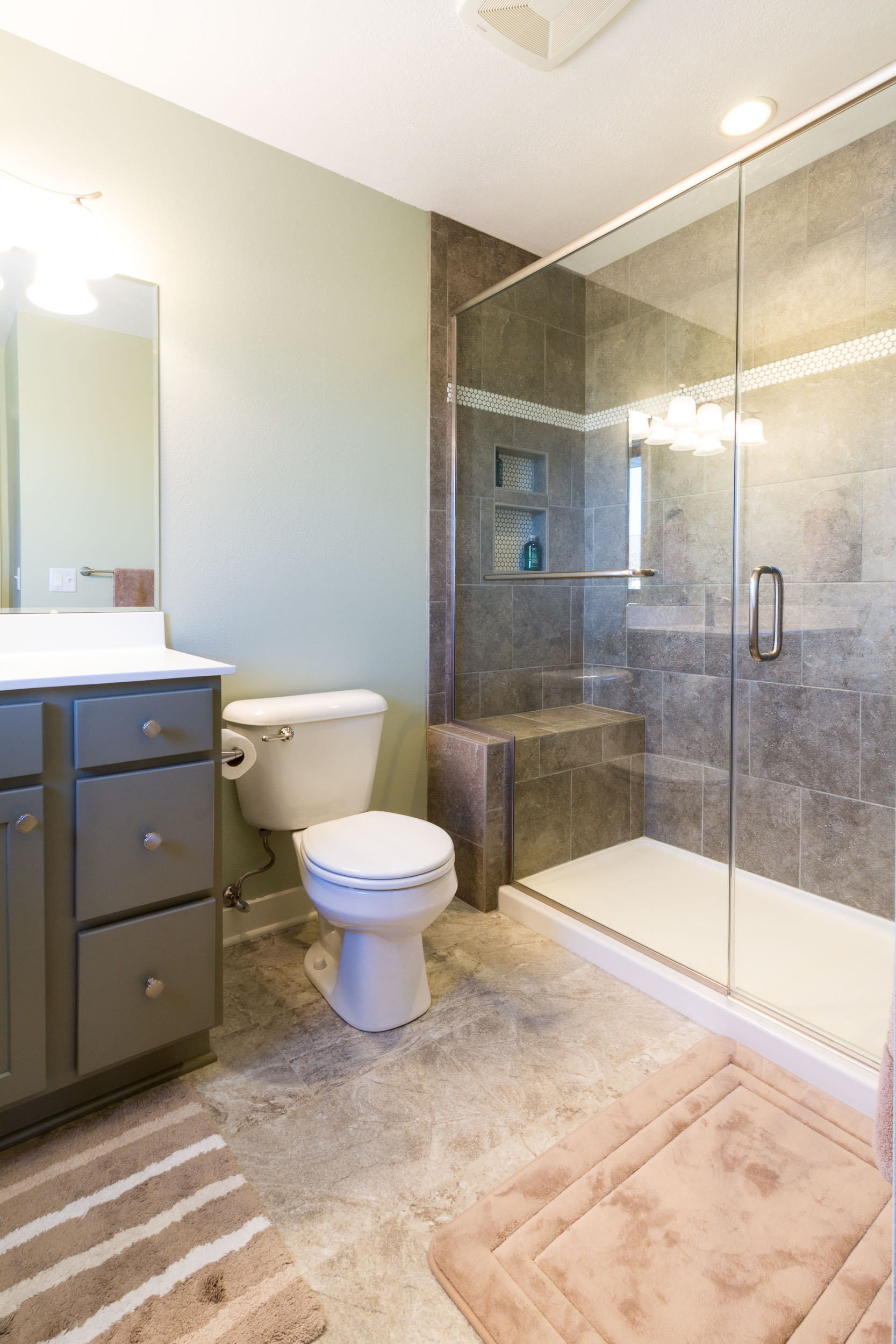 - A jetted tub was removed and this shower installed while remodeling this master bathroom in Waunakee, WI.