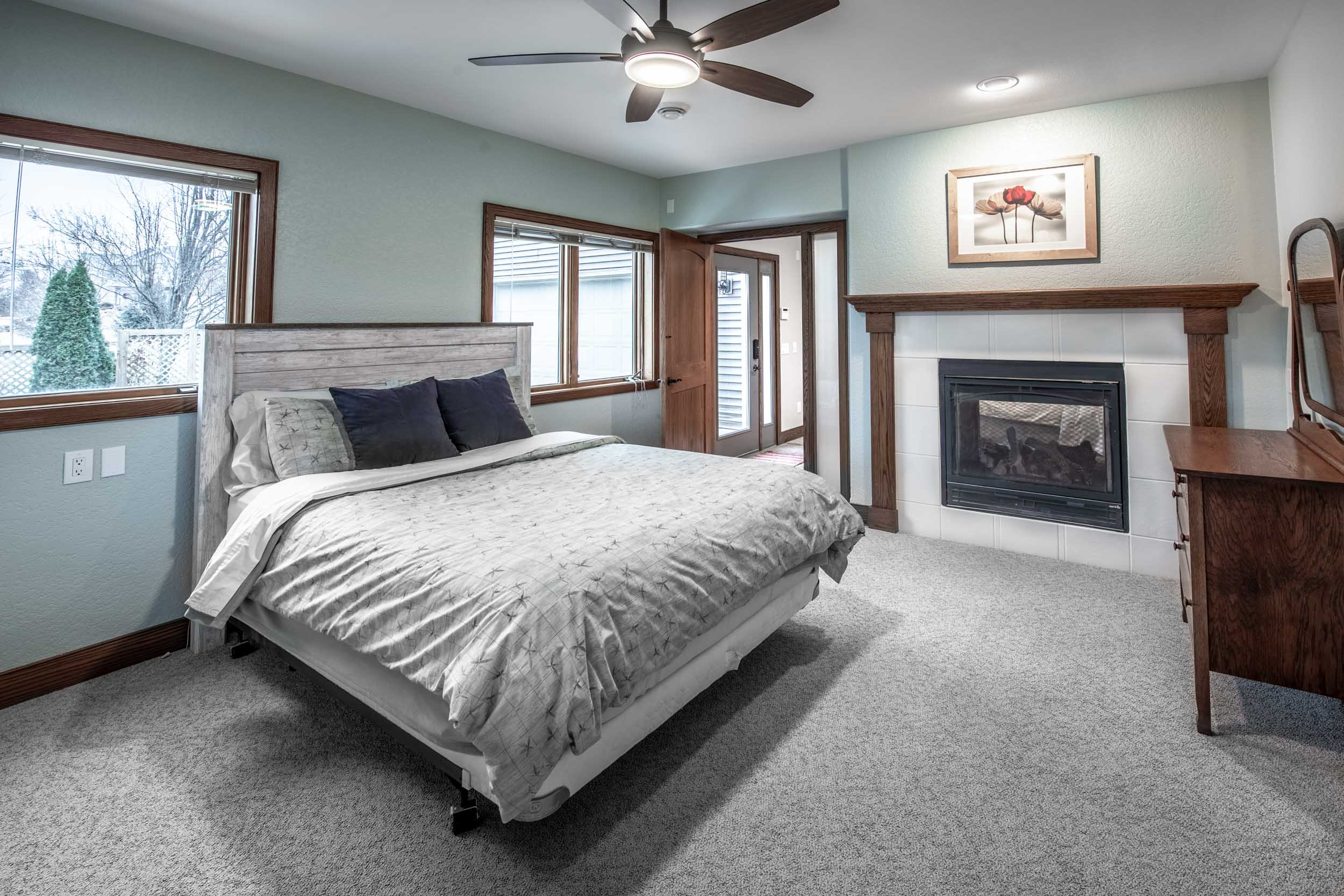 Finished Basement Guest Bedroom With Fireplace