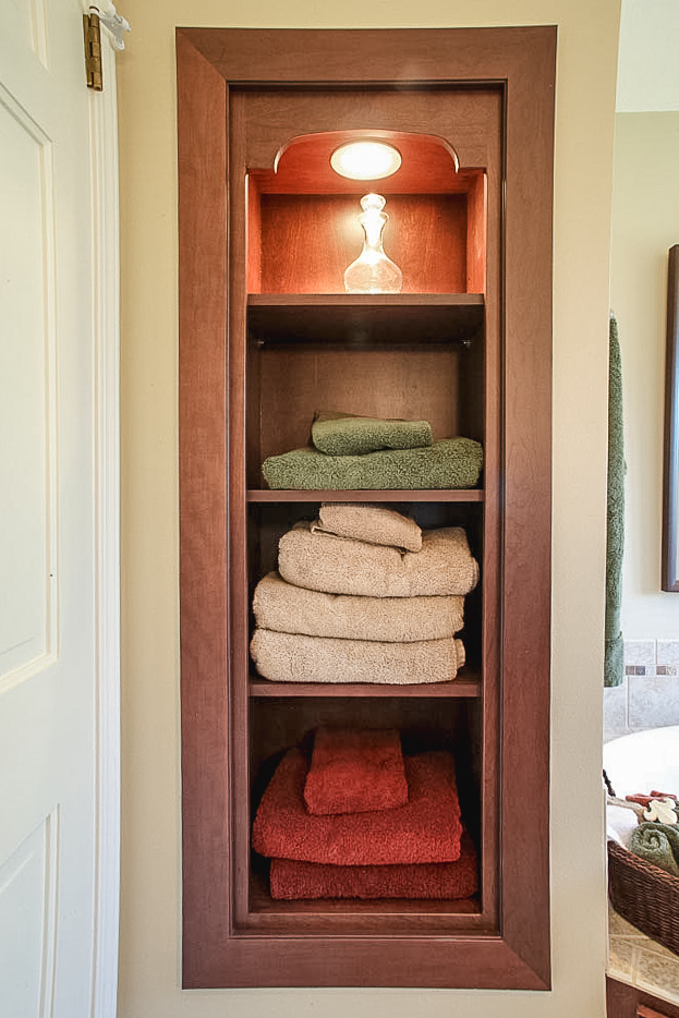 - A storage niche for towels utilizes space formerly wasted in an oversized chimney chase.
