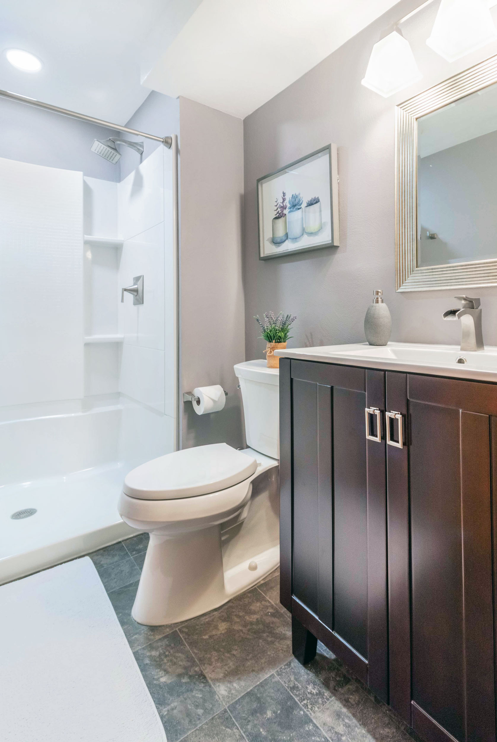 A Half-Bath redesigned To Accommodate A New Shower