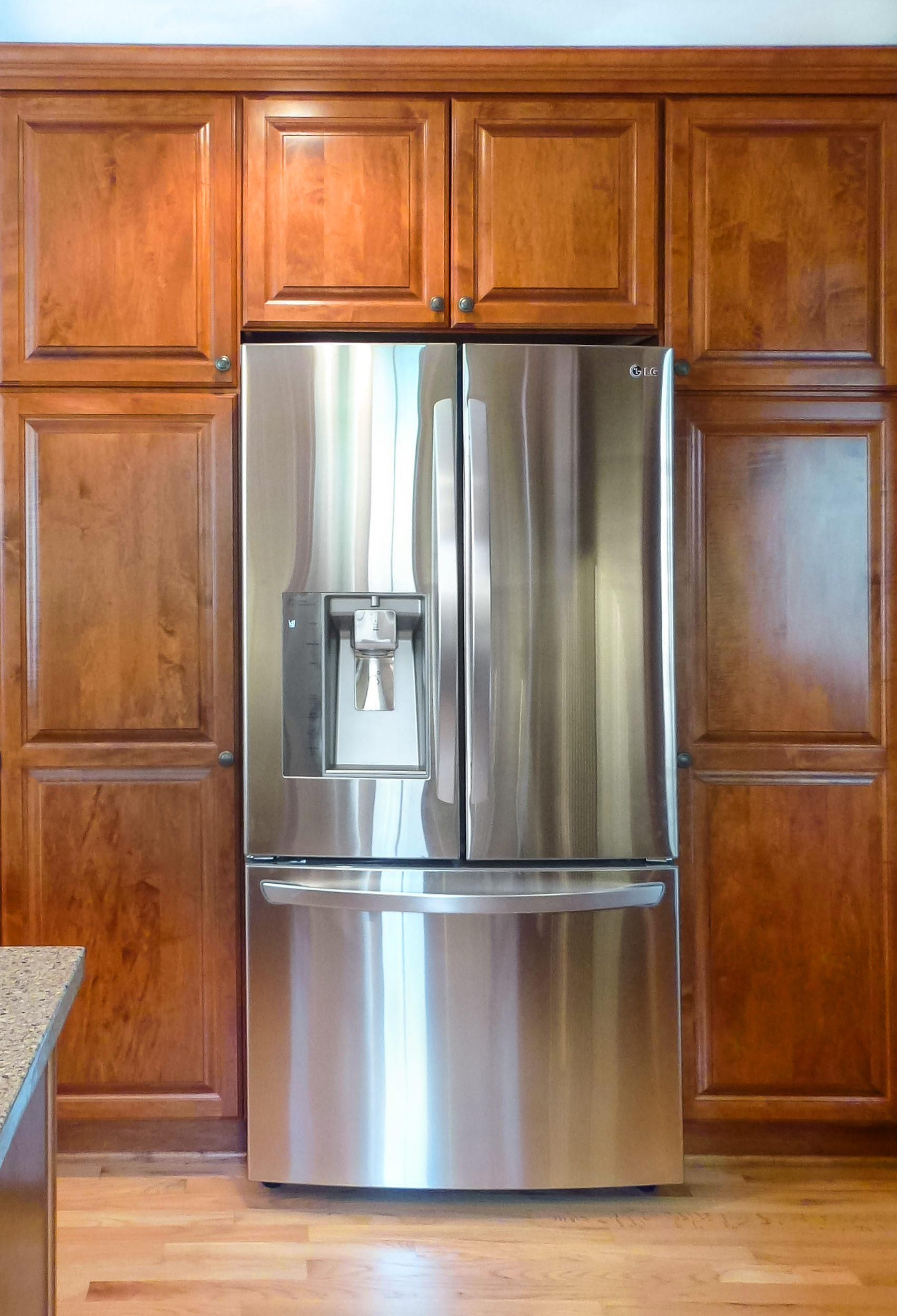 The new kitchen has LG appliances including a cabinet depth refrigerator.