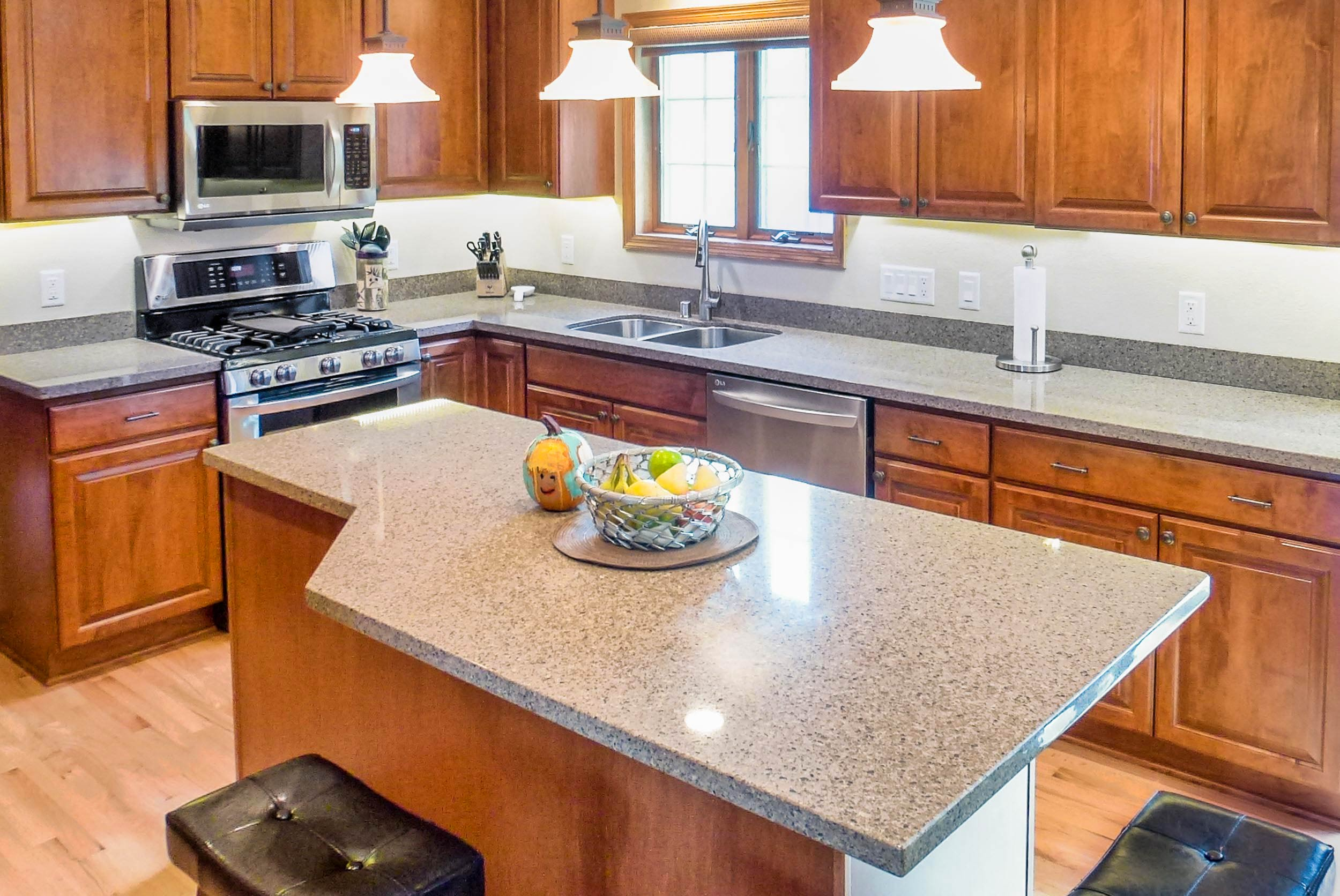 The countertop is Viatera Quartz, in the Solar Canyon color.