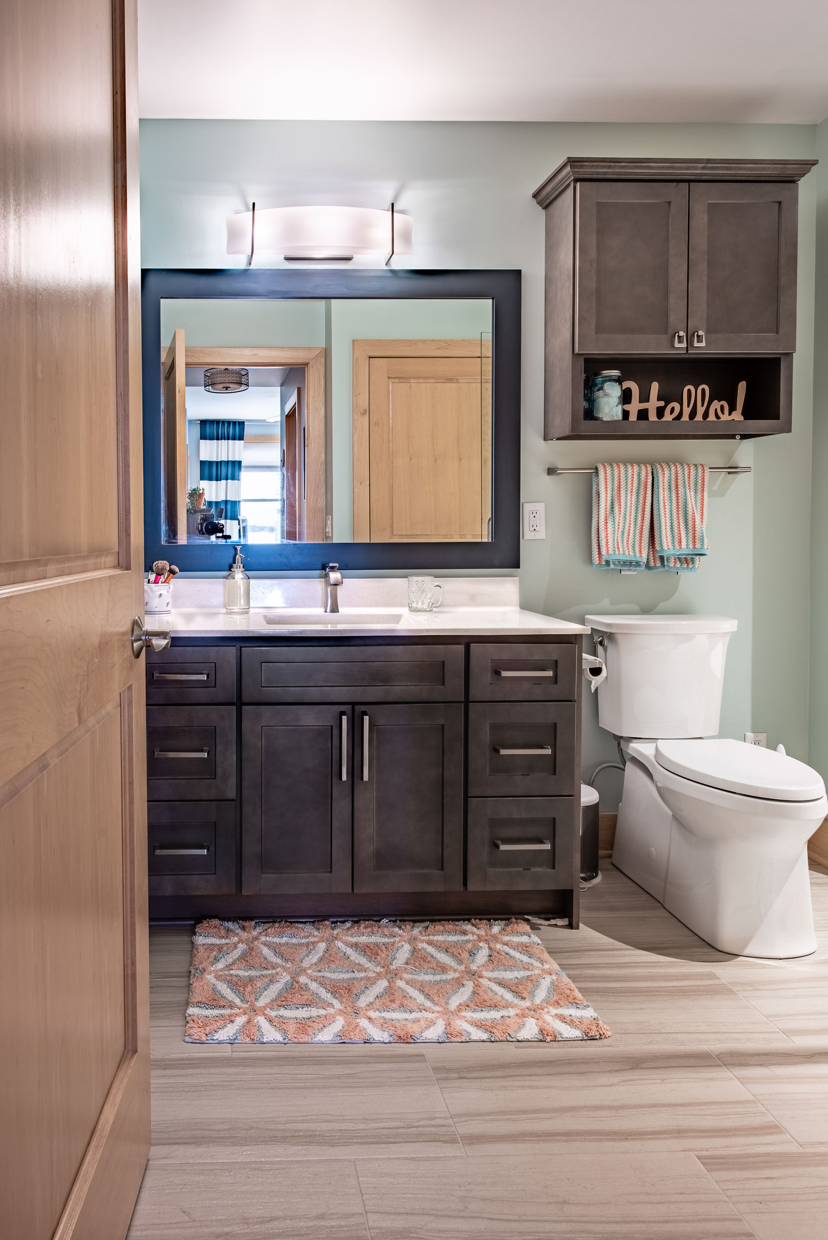 Th vanity is by Homecrest cabinets. The door style is Sedona in a Dover stain.