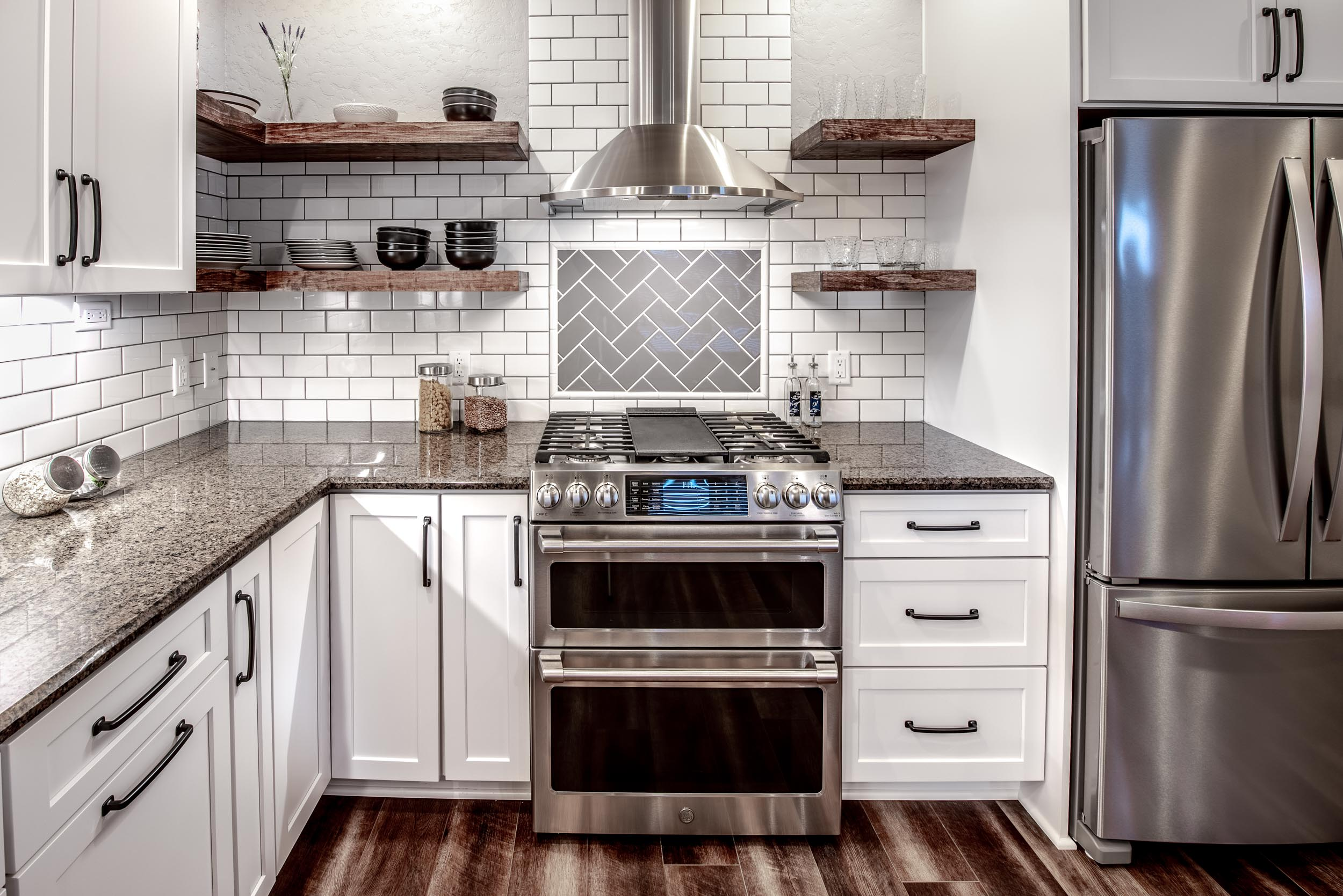 - This elegant stainless steel chimney hood provides a beautiful focal point and has high quality lighting for the gas range below.