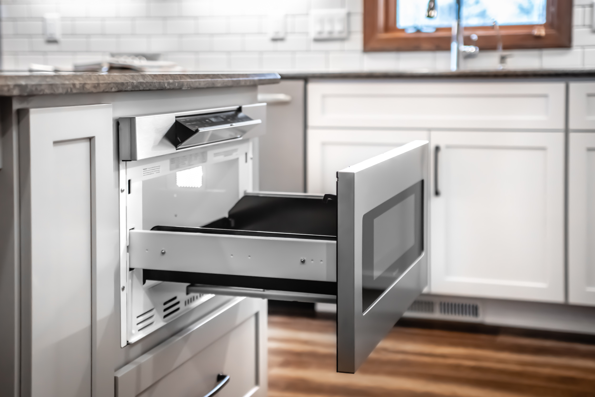 - Instead of an Over-The-Range microwave, a Microwave Drawer can be the perfect solution of where to place the microwave, so that a functional, quiet, and beautiful range hood can be installed.