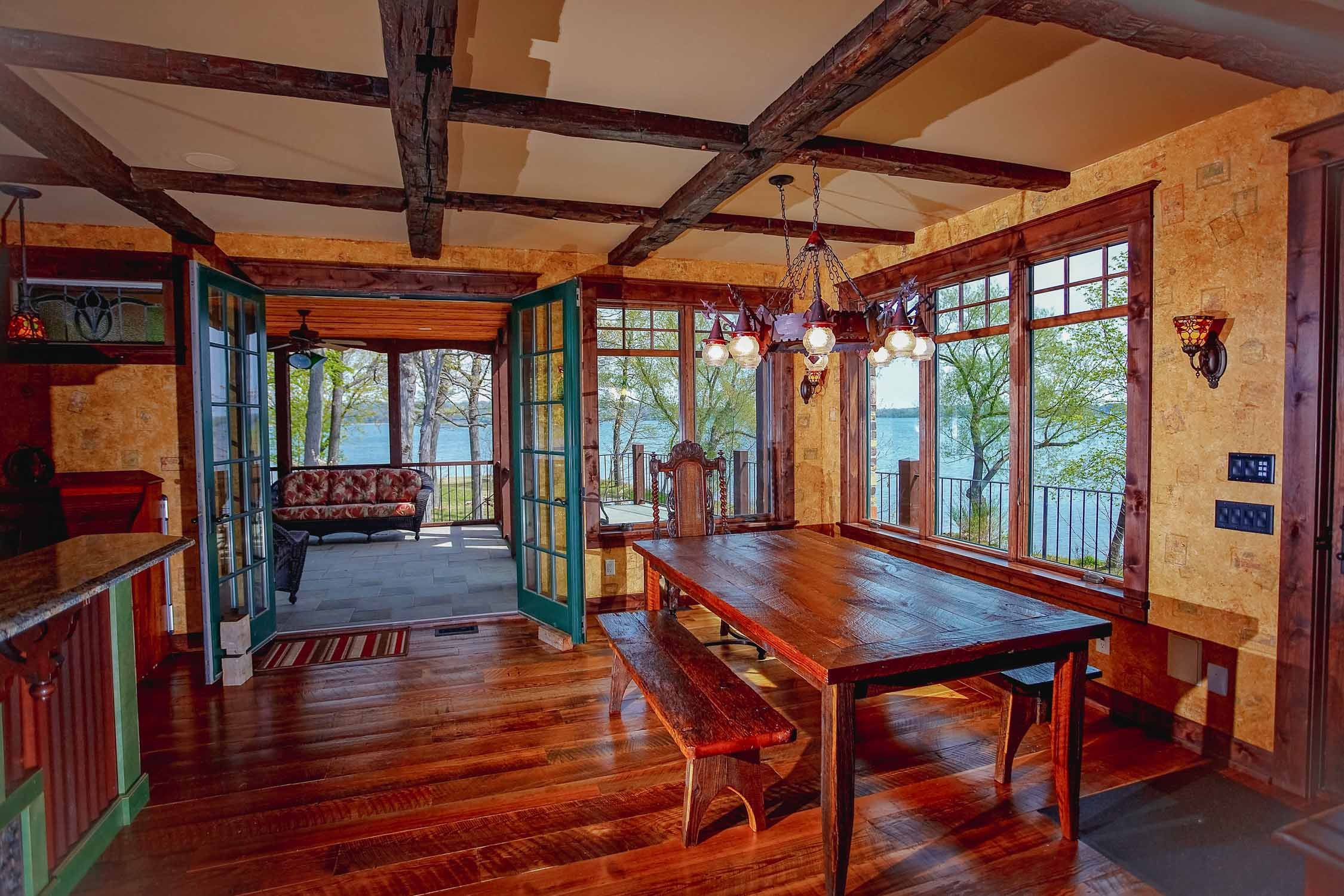 - This one-of-a-kind Storybook home includes rustic elements such as the beamwork and salvaged flooring, interspersed with large windows and a modern open floor plan.