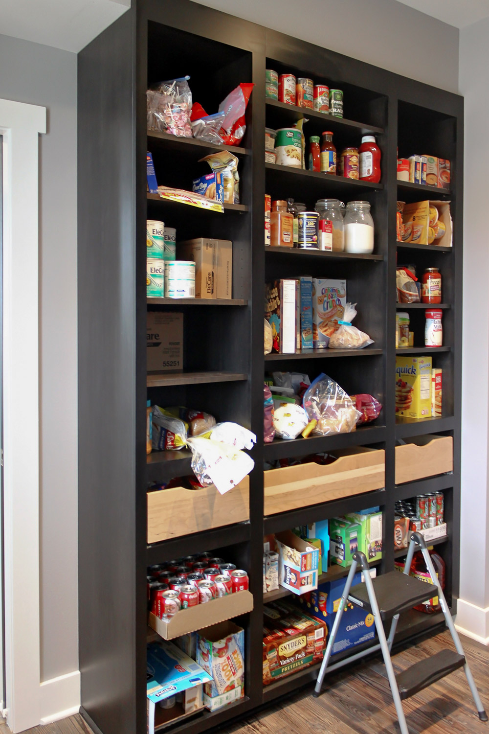 - This walk-in pantry contains shelves, roll-outs, and even the refrigerator, freezer and microwave (not pictured here).