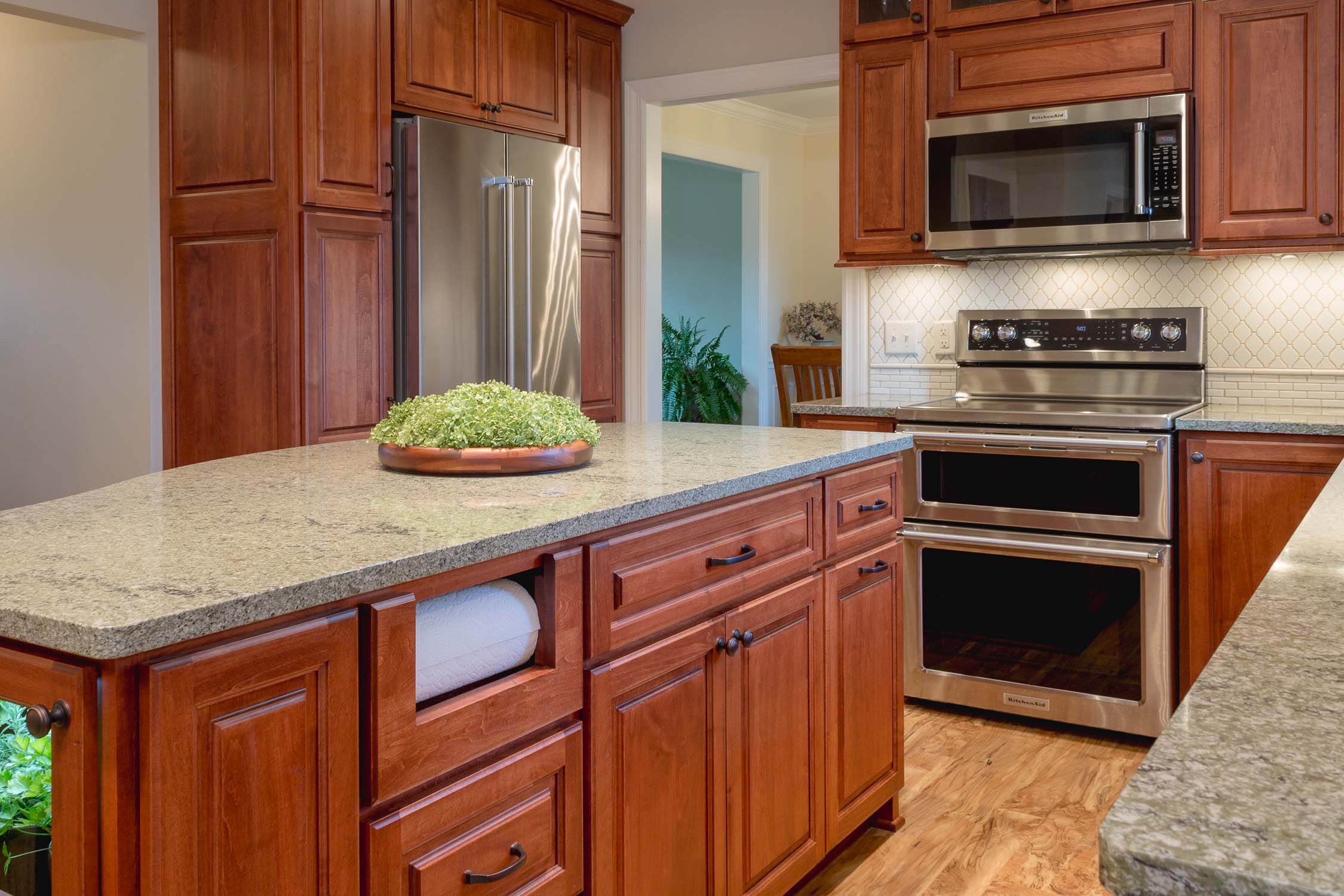 """- These standard pantry cabinets make the full-depth refrigerator look like a counter-depth fridge, by installing a 27"""" deep end panel on the left side of the cabinet."""