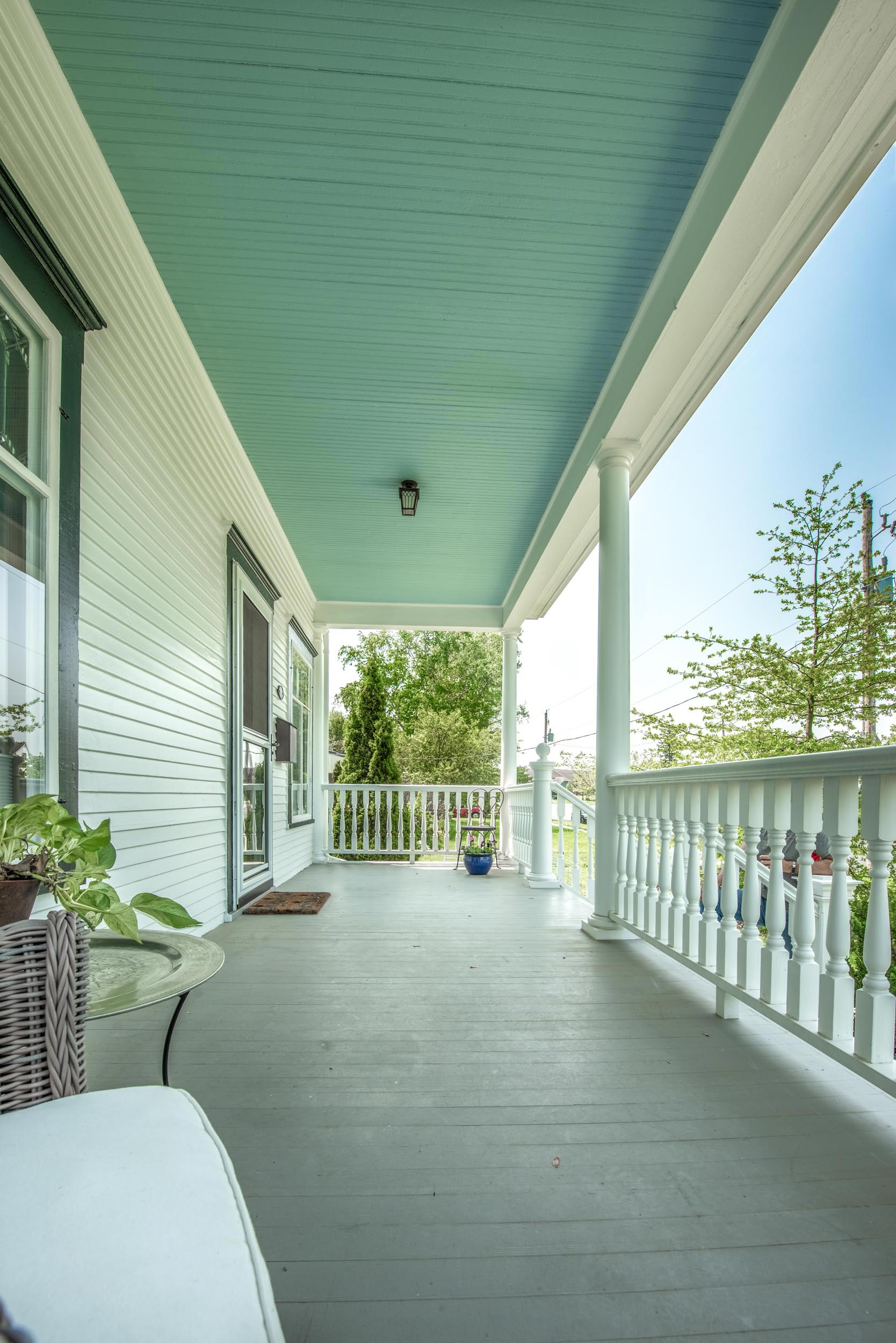 Traditional Victorian Porch Design with blue Ceiling