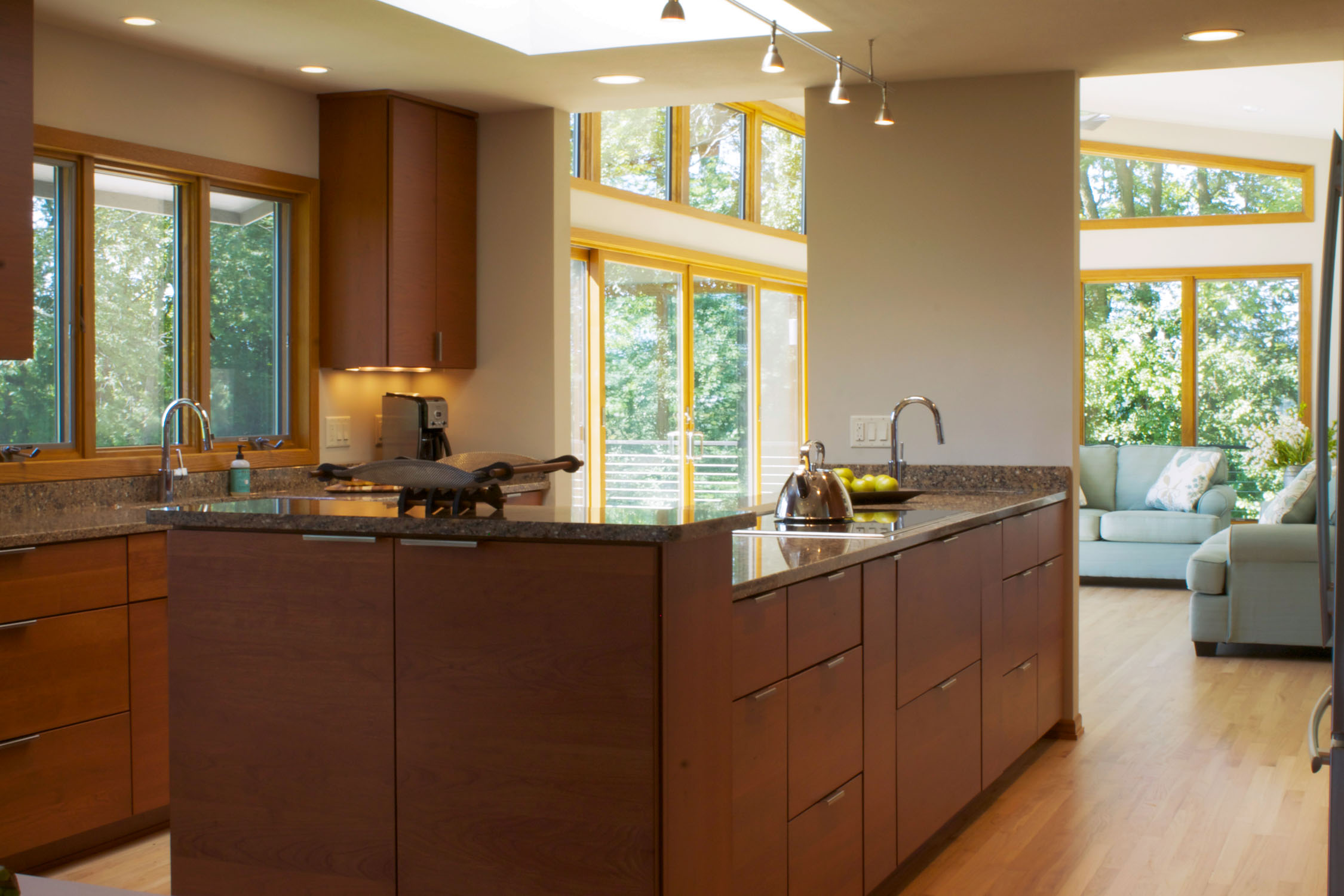 - This remodeled kitchen in Westport, WI features an oversized window at the kitchen sink, a skylight over the island, and a two connections to the adjacent sunroom.