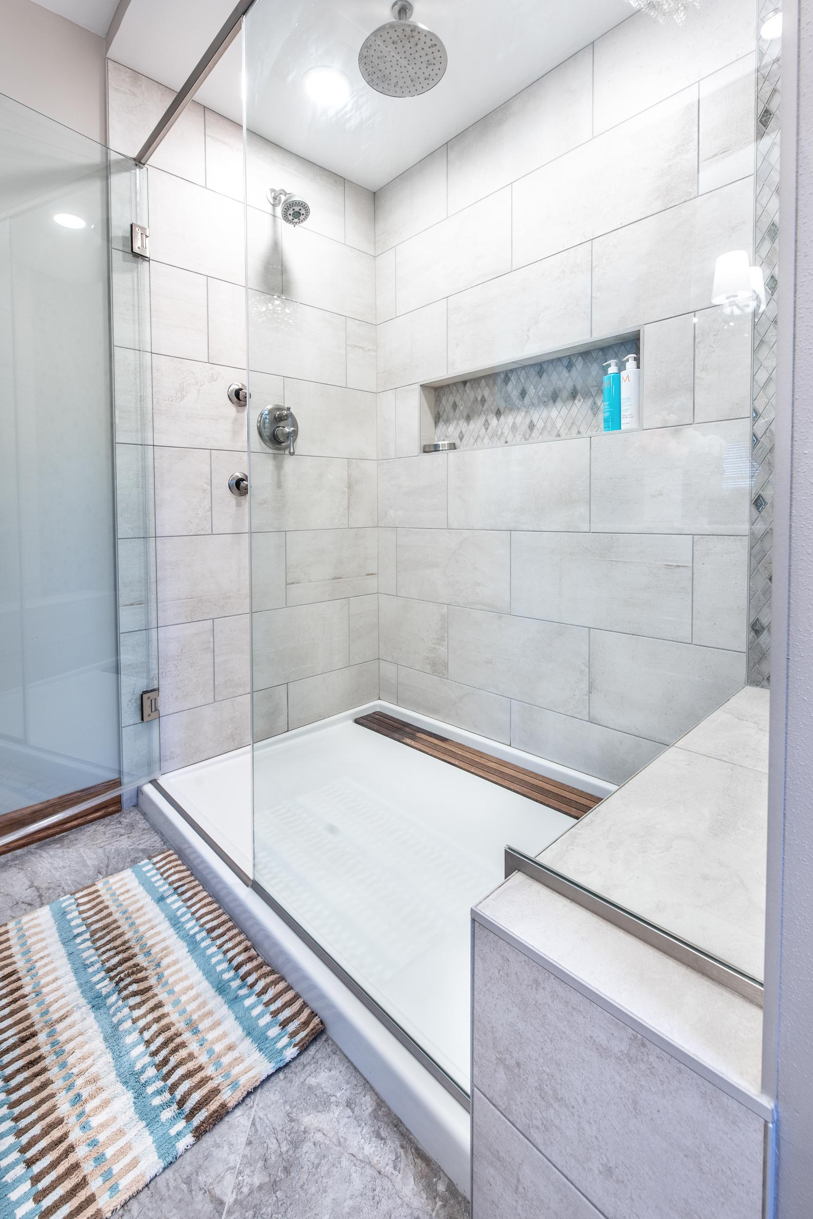 """The Shower Tile is Biocrete Field 12"""" x 24"""" in Melted Ice."""