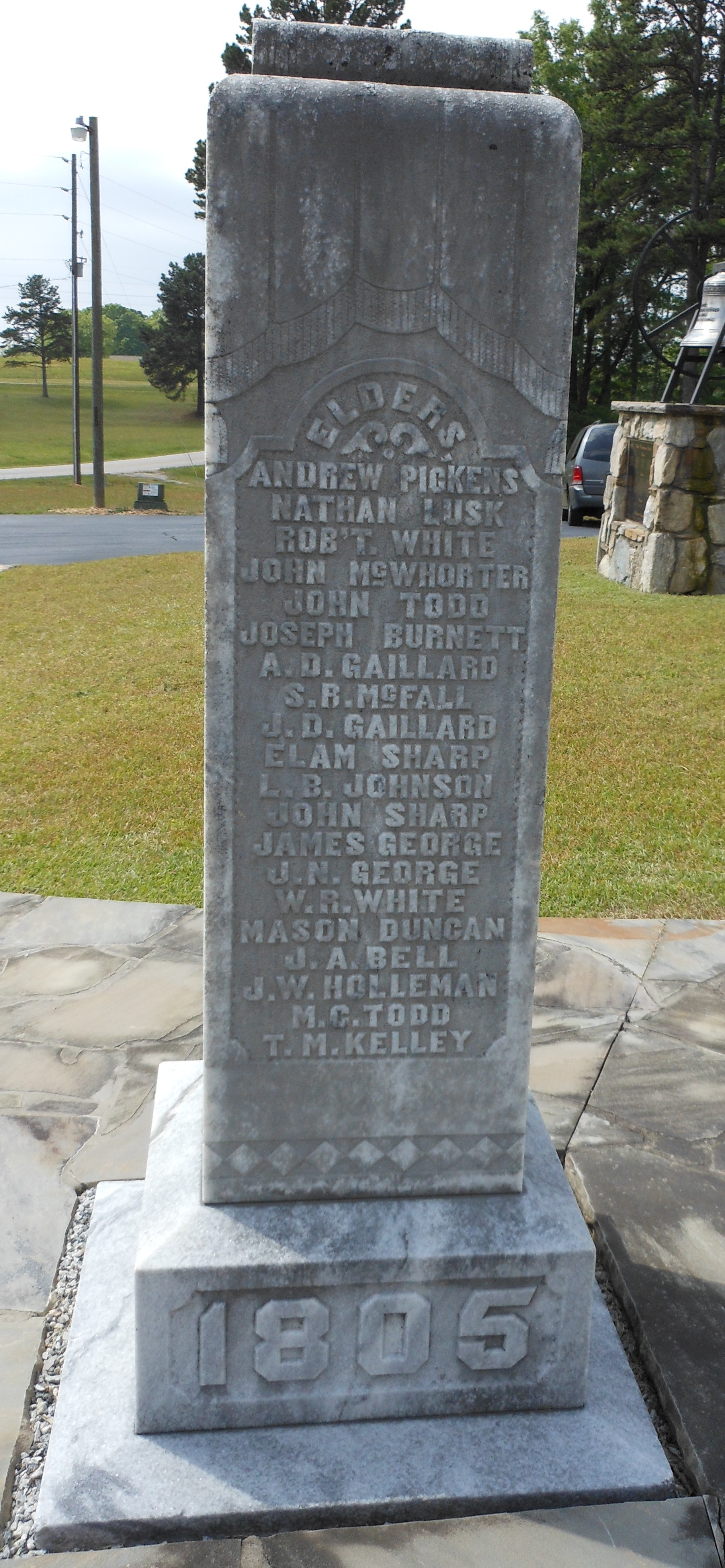 On August 10, 1905, at 3:30 o'clock the  centennial monument  was unveiled by Cornelia Pickett, a descendant of Samuel McFall, and Kate Sharp, a descendant of John Sharp. The marble monument stands 8½ feet and has engraved on it the names of the officers of the church from 1805−1905.