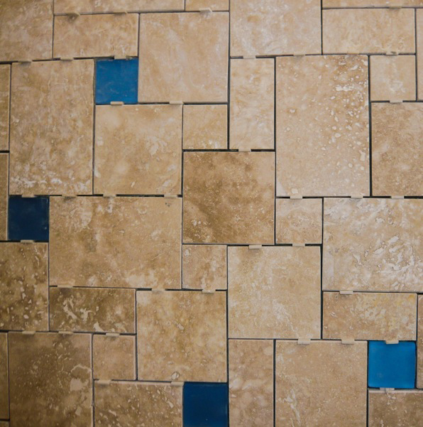durango travertine and blue glass tiles, ashlar pattern, tile spacers still in place