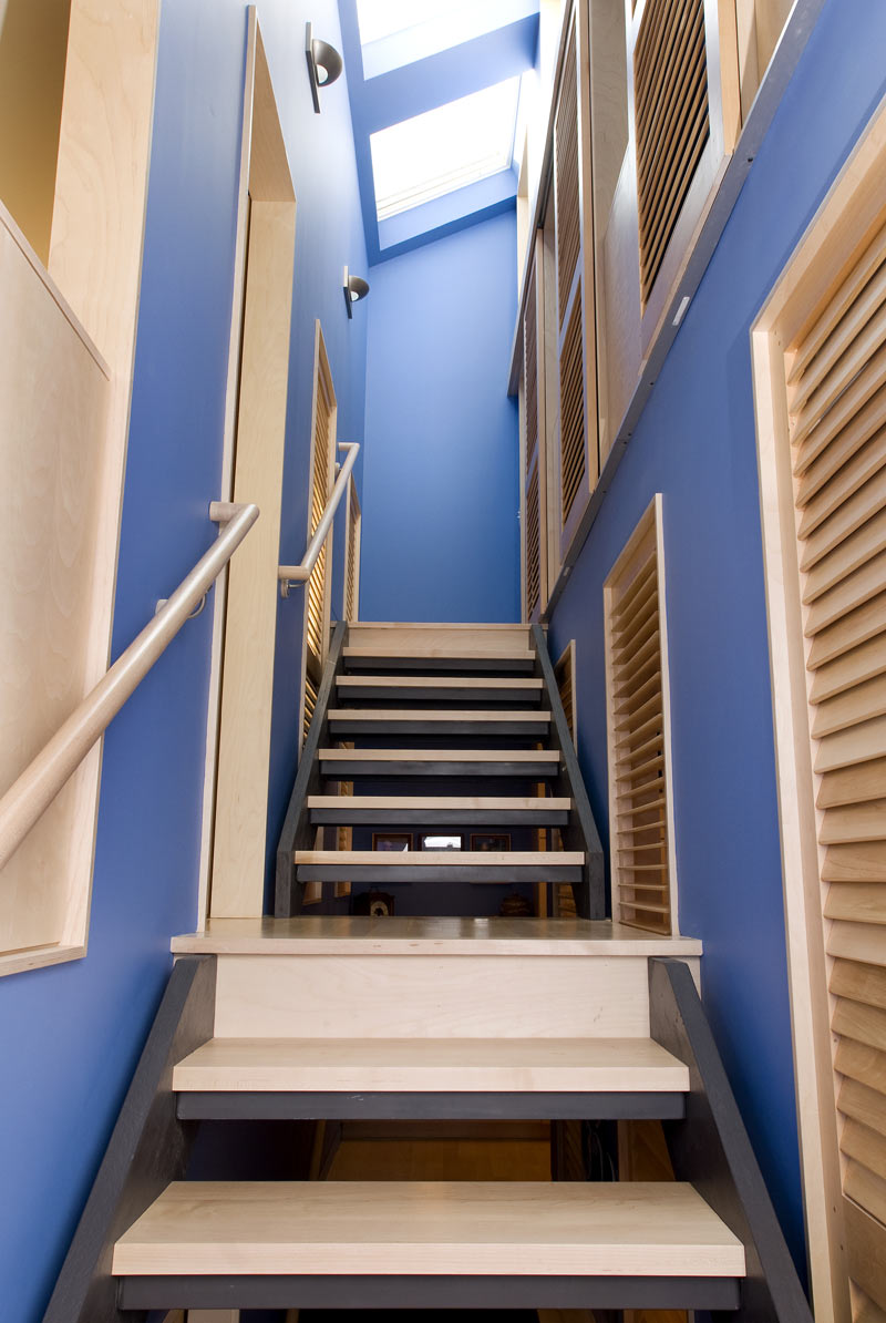 double stringer open riser stair with maple treads.jpg