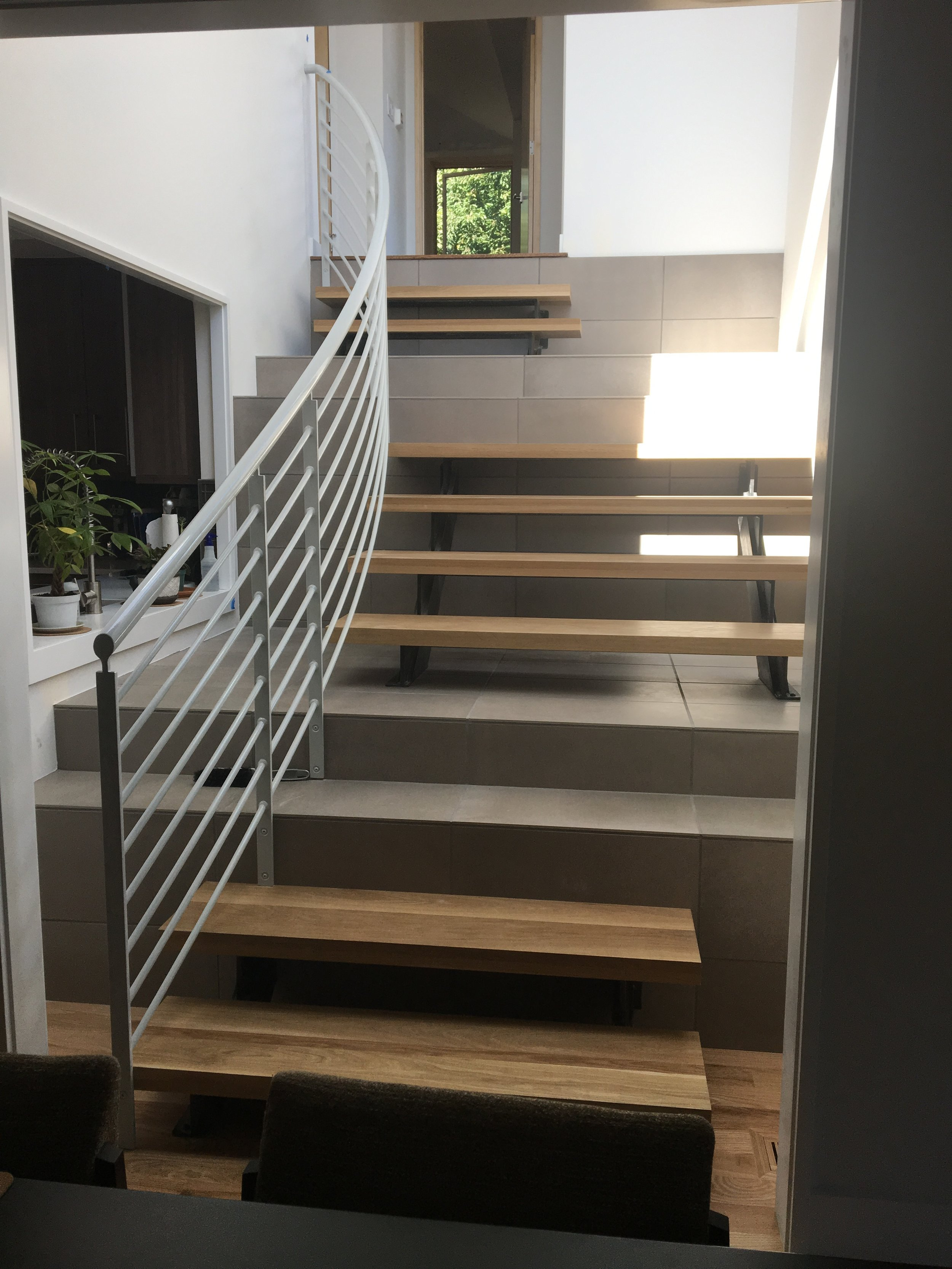 wood and tile stair with steel rail.JPG
