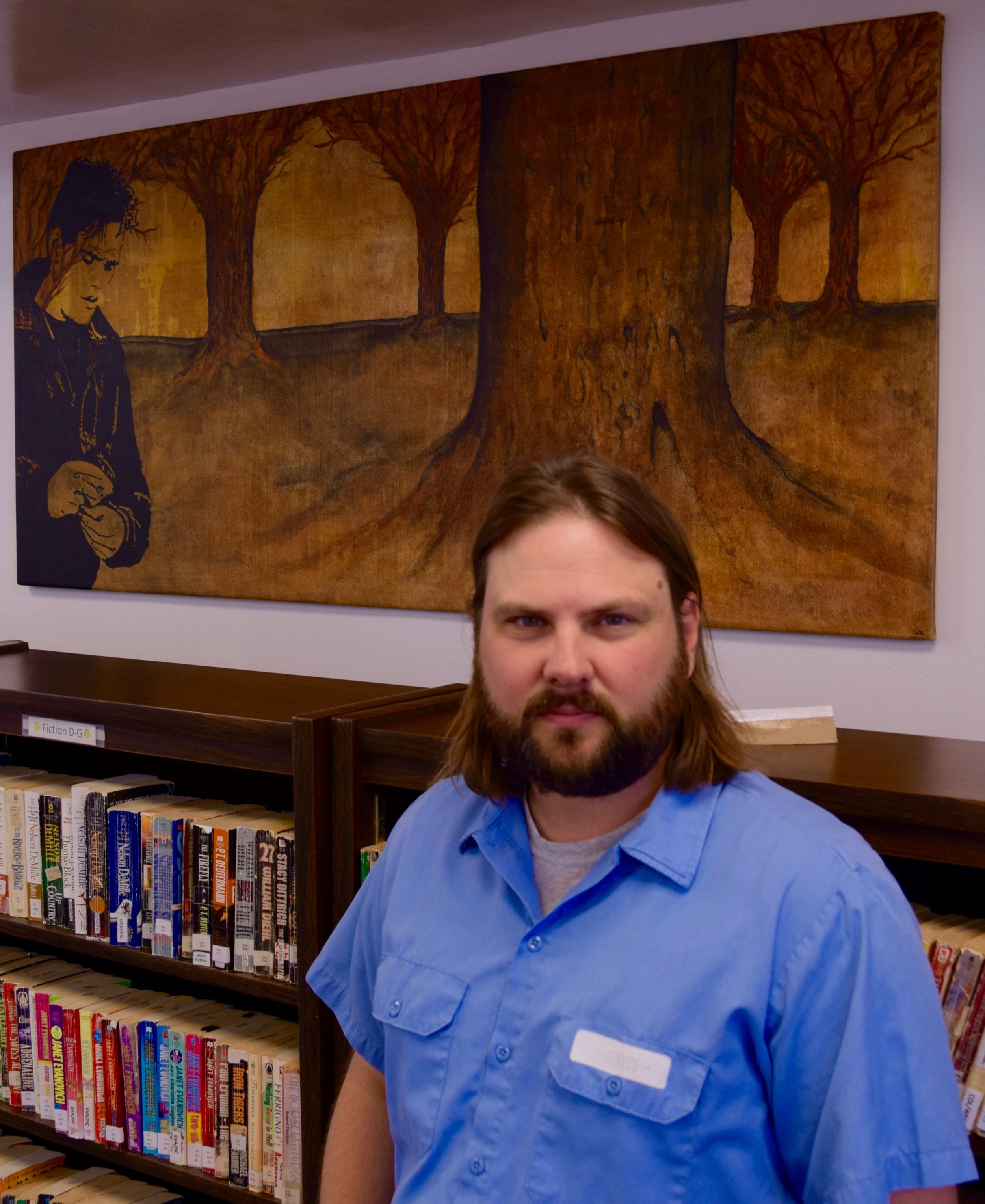 Livingston in the library with one of his paintings in the background. Photograph: Adrian Brune