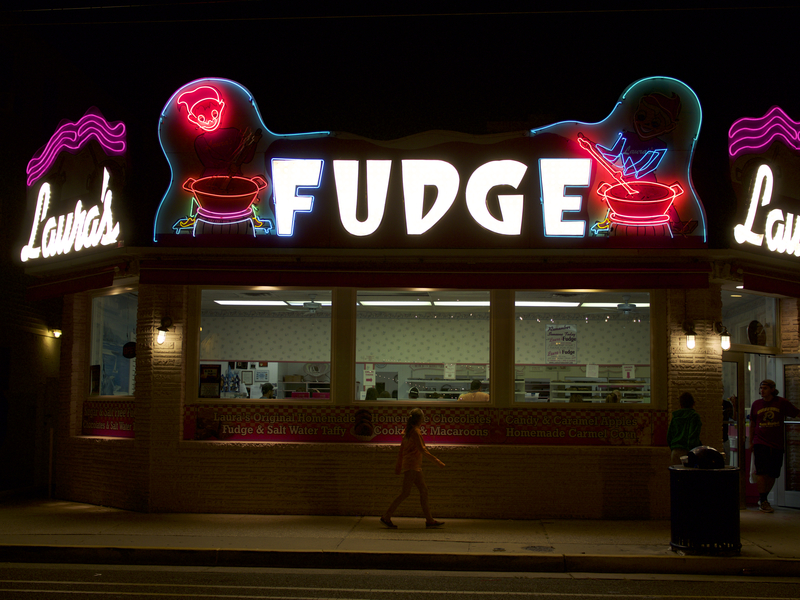 A passer-by ponders the lights at Laura's Fudge Shop in Wildwood, New Jersey. One of the first stores near the boardwalk, Laura's opened in 1926 and sells online in the off-season. (All photos: Raphaelle Guillon)