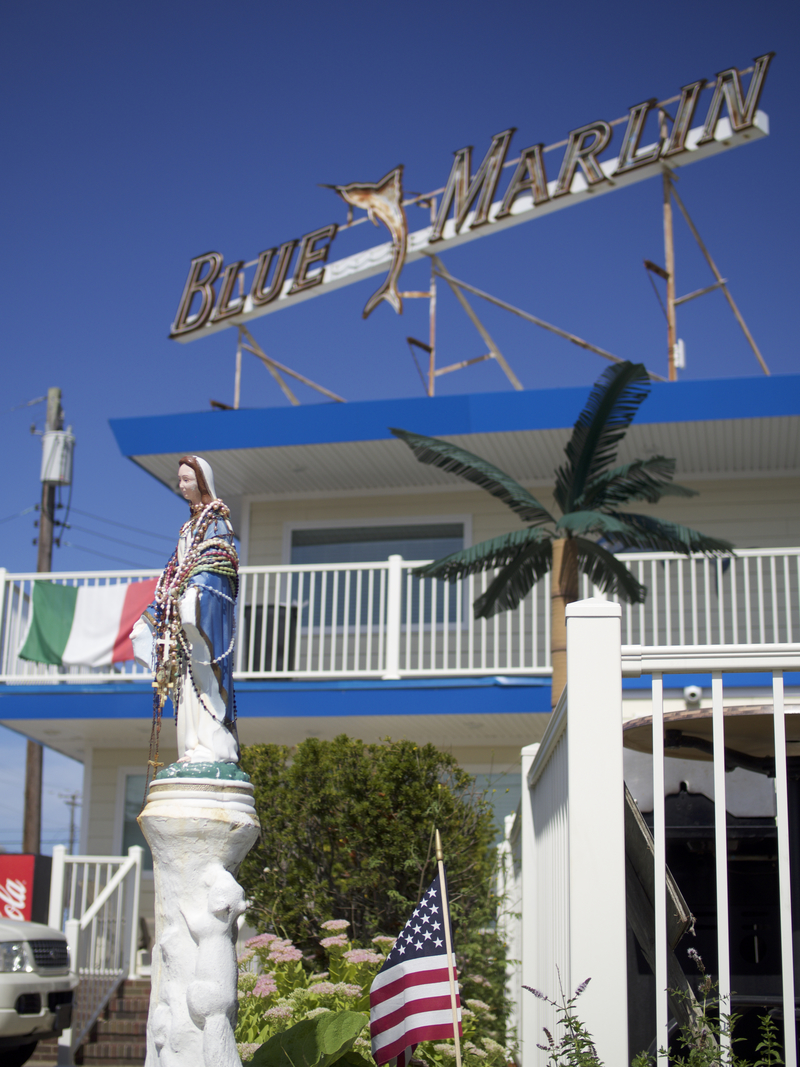 A statue of the Virgin Mary stands guard over the recently renovated Blue Marlin motel. A staple of the area for nearly 50 years, the Marlin suffered from noisy guests and outdated amenities until Mary came along with new ownership.