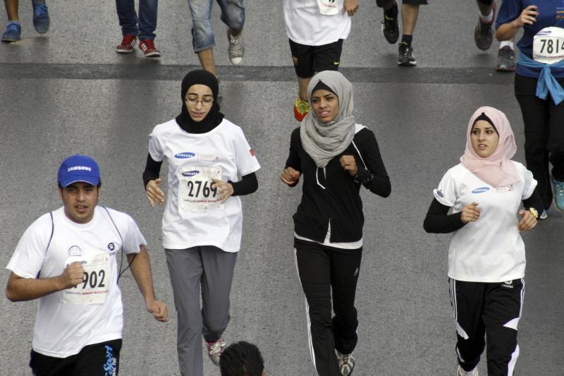 Runners take part in the fifth Amman International Marathon in Amman, Jordan, October 4, 2013.
