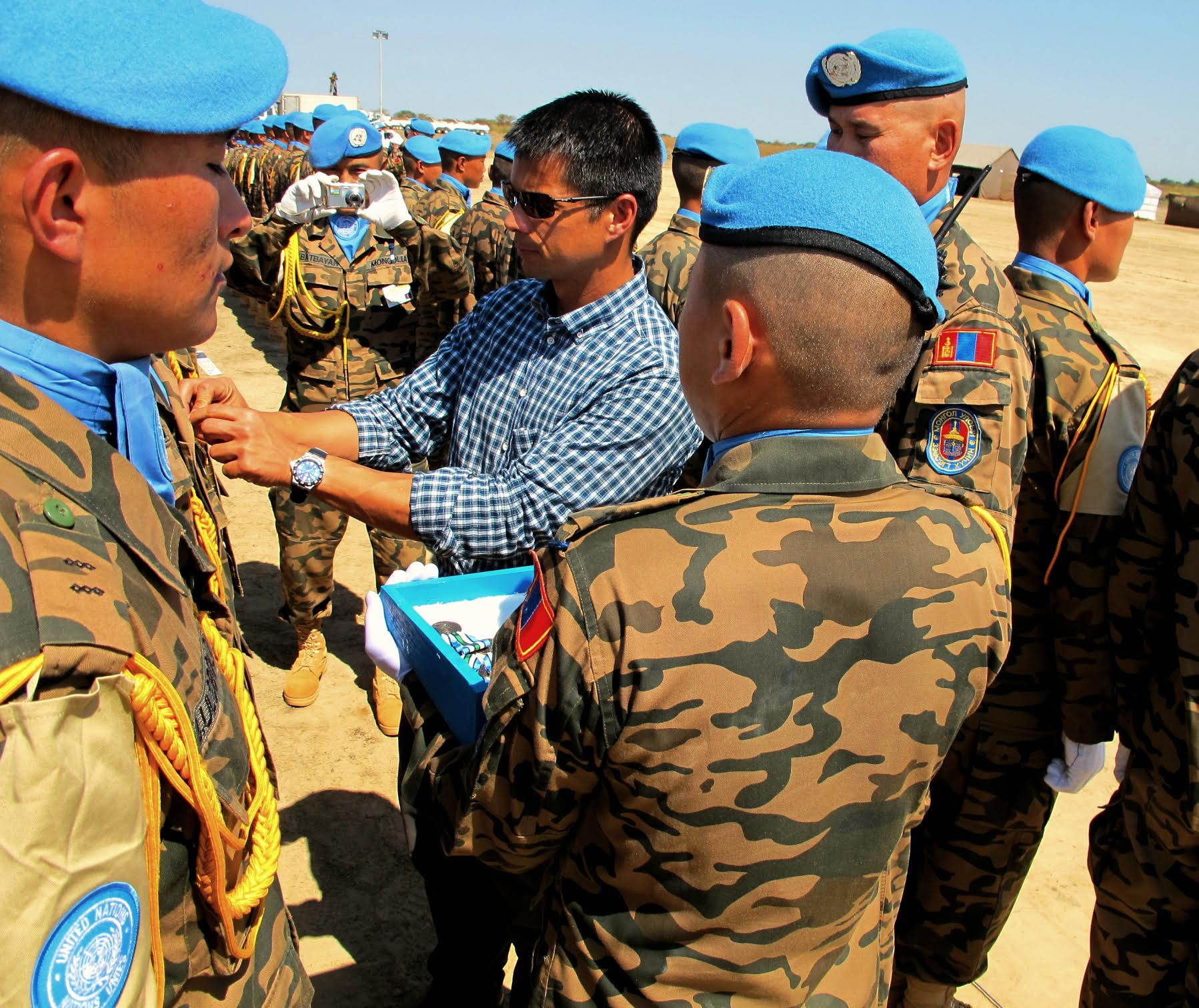 Payumo pins medals on Peacekeepers in South Sudan.SOURCE KEN PAYUMO