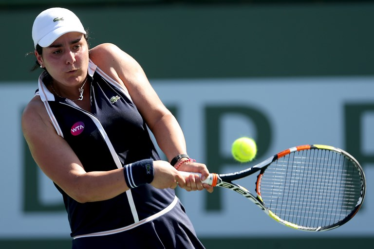 Ons Jabeur of Tunisia bears down at the 2015 BNP Paribas Open in Indian Wells, California.SOURCE  MATTHEW STOCKMAN/GETTY