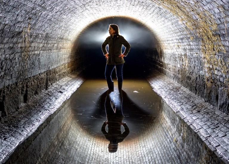 Author Adrian Brune poses for Grange in a retired Long Island aqueduct once used to transport water to Brooklyn.  COURTESY OF LUCINDA GRANGE