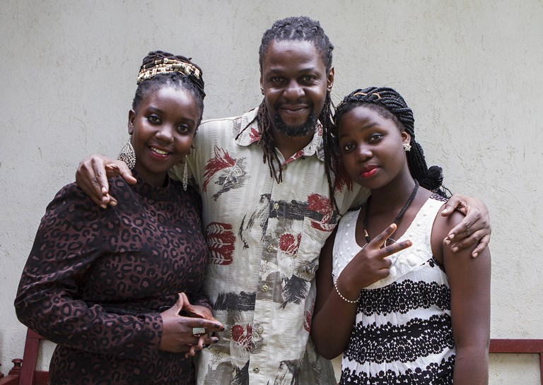 Lady Slyke (left), Daniel Kisekka (aka Survivor) and Zoe Kabuye (aka MC Loy) at NewzBeat's offices in Kampala. Ugandans call the team of broadcasters rap-orters — hip-hop artists turned journalists who rap the news headlines.SOURCE  ISAAC KASAMANI/AFP/GETTY
