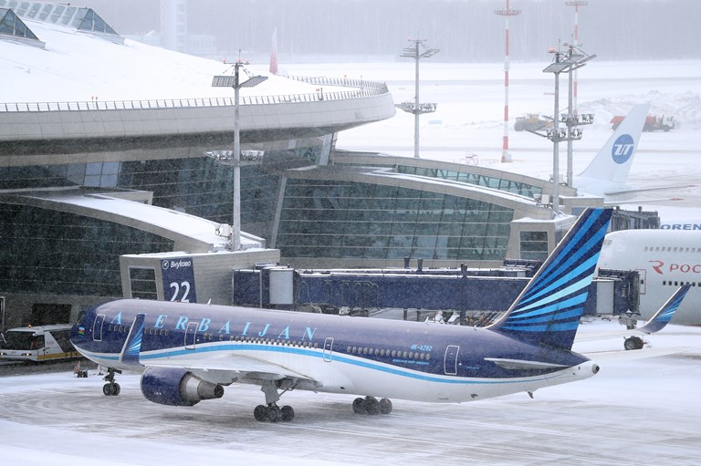 An Azerbaijan passenger plane at Vnukovo Airport during a snowstorm.SOURCE  MARINA LYSTSEVA/GETTY