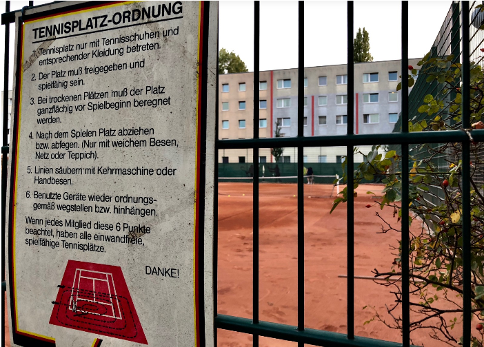 "The rules posted on the courts of Tennisclub Berlin Mitte Albert Gutzmann, e.V. The city alleges that the club has been breaking ordinances of its own. For years, Berlin administrators say, the ""Mitte"" has been using four tennis courts on land owned by a school next door."