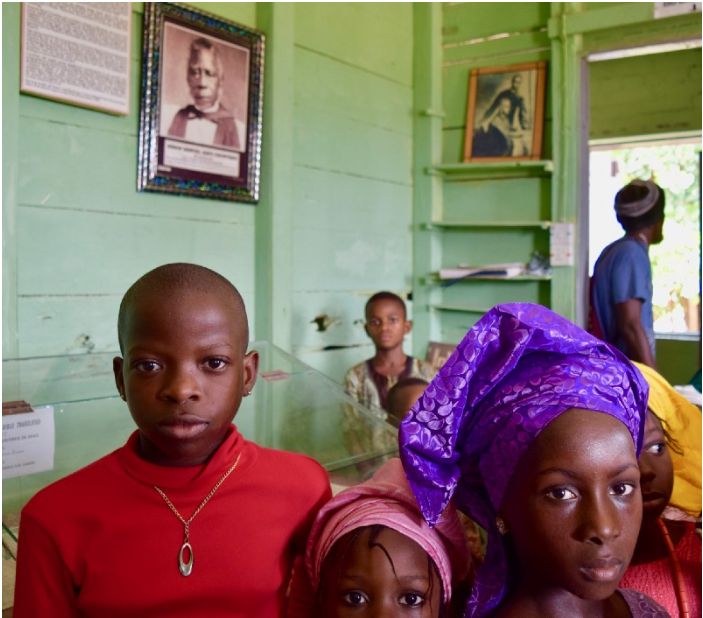 At the Badagry Slave Museum, youngsters, such as these, learn about the legacy of slavery and colonialization from local residents who moonlight as tour guides. According to local stories, modern education was brought to Nigeria in the mid-18th century by early English settlers.