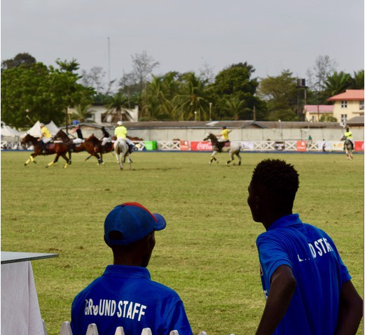 Staff watch a polo match at the Lagos Polo Club in February 2018.