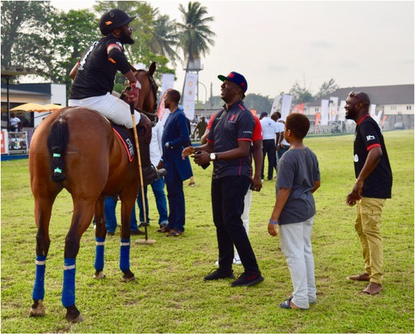 Onlookers celebrate a victory at the Lagos Polo Club in Lagos, Nigeria in February 2018.