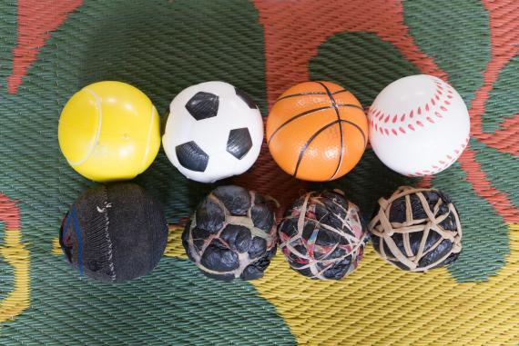 Sponge balls made by parents and children next to a set of UNICEF's bouncy balls. Balls encourage movement, muscle strengthening and dexterity among children.