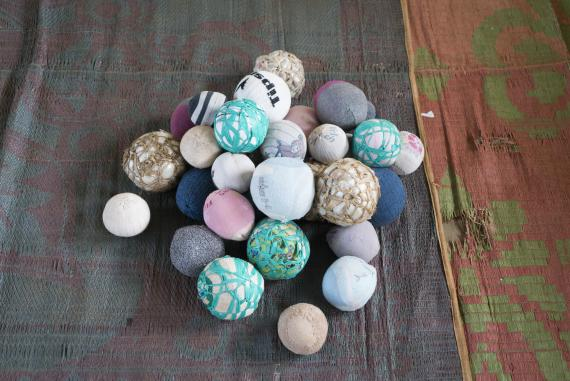 Sponge balls made by South Sudanese from patterns donated by UNICEF. Balls can be used for a number of games: hide and seek, catch, or simply to bounce.