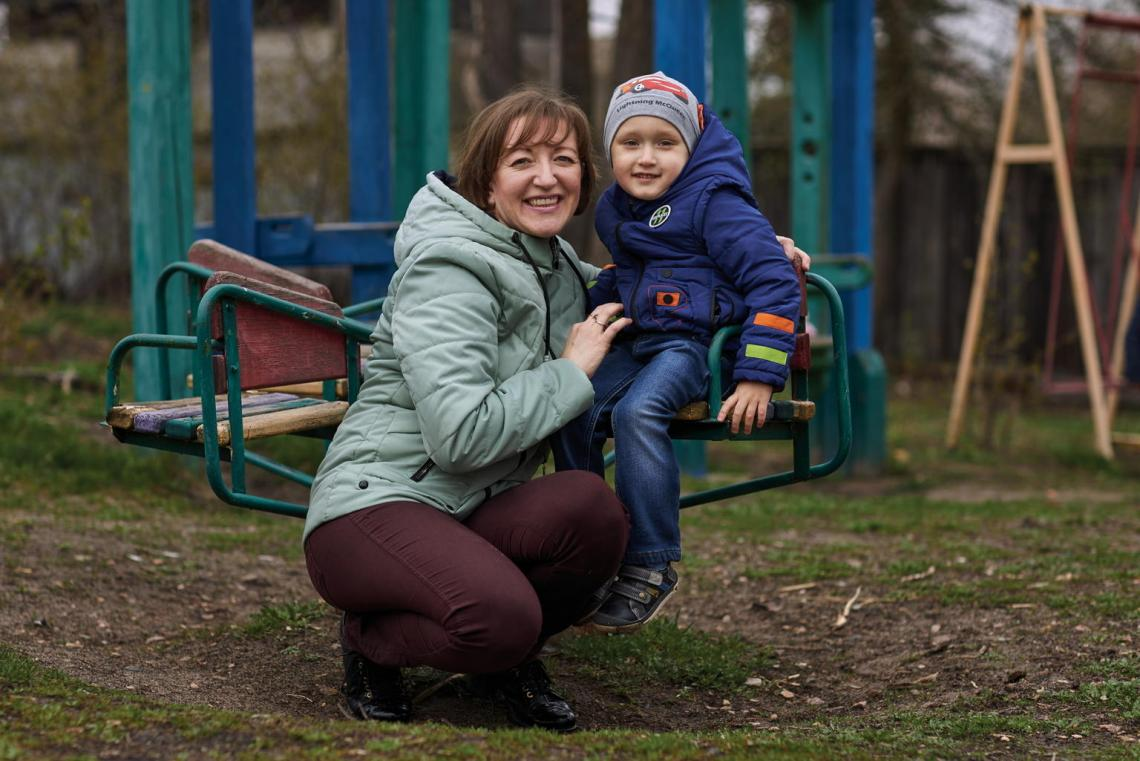 "Svitlana Ovdiy plays with her son Kyrylo, 3, a tetanus survivor, near their house outside Kyiv. The infection put Kyrylo in a medically-induced coma, and he spent 50 days in the hospital. ""When he heard my voice... he started crying, calling for help, but there was nothing more I could do,"" Svitlana recalls. ""Now vaccination is a top priority issue in our family."""