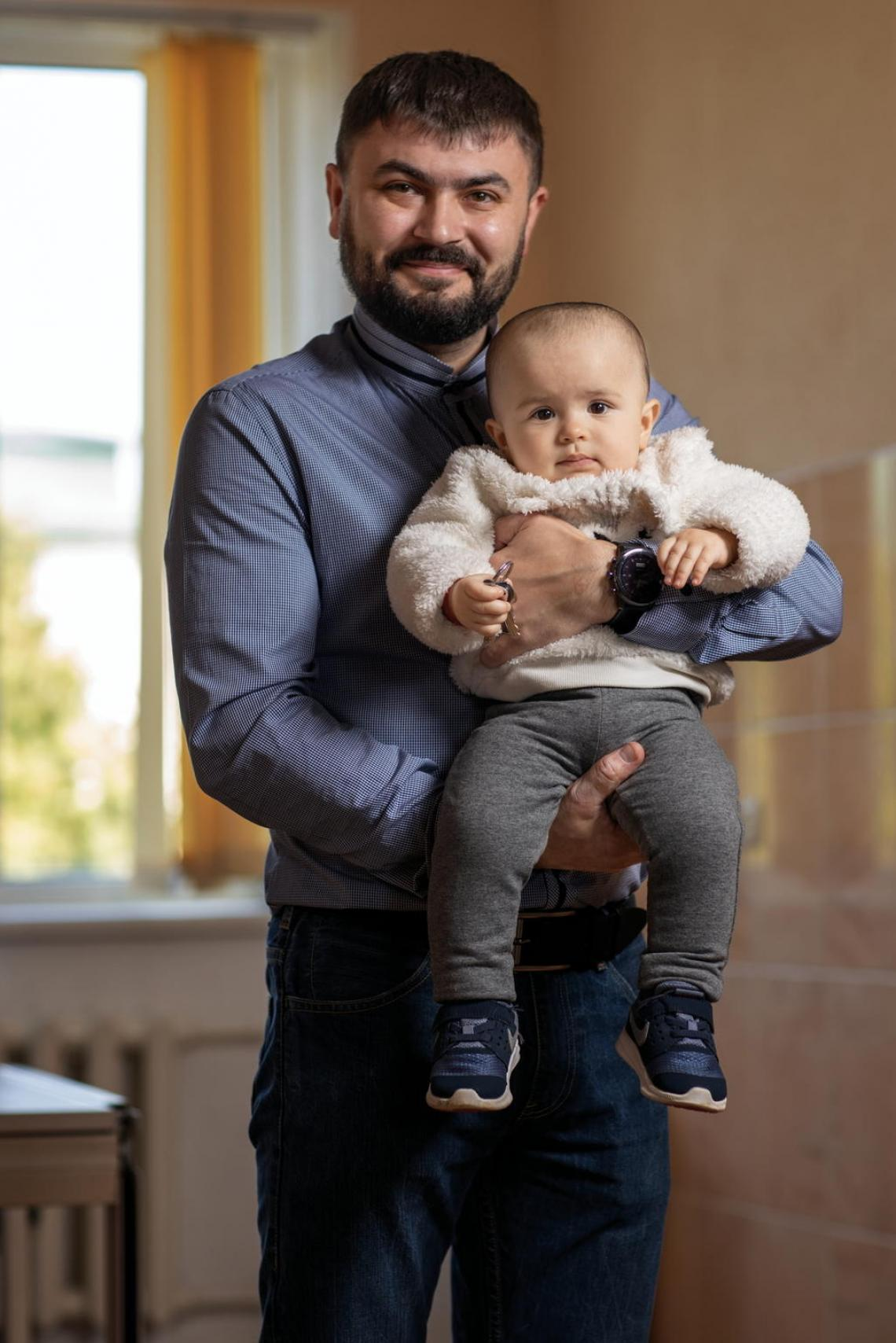 Serhiy Oliynyk, a paediatrician, holds his daughter Katya, age 1, before setting off to work at Kosiv hospital in Western Ukraine. Serhiy promotes vaccines among his patients and recently had Katya inoculated against measles. Children should generally receive their first dose of the MMR vaccine at age 1; babies at high risk of contracting measles, especially during an outbreak, can receive the MMR shot as early as 6 months.