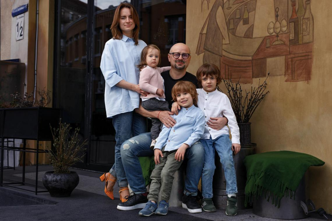 "After his middle son contracted chickenpox, Igor Sukhomlyn, a restaurateur and thought leader in Kyiv, was not willing to take any chances. He and his wife immediately vaccinated other members of the family from chickenpox, and no one else got sick. ""Vaccination is a valuable scientific achievement,"" says Igor, pictured with his wife and children in front of his restaurant."