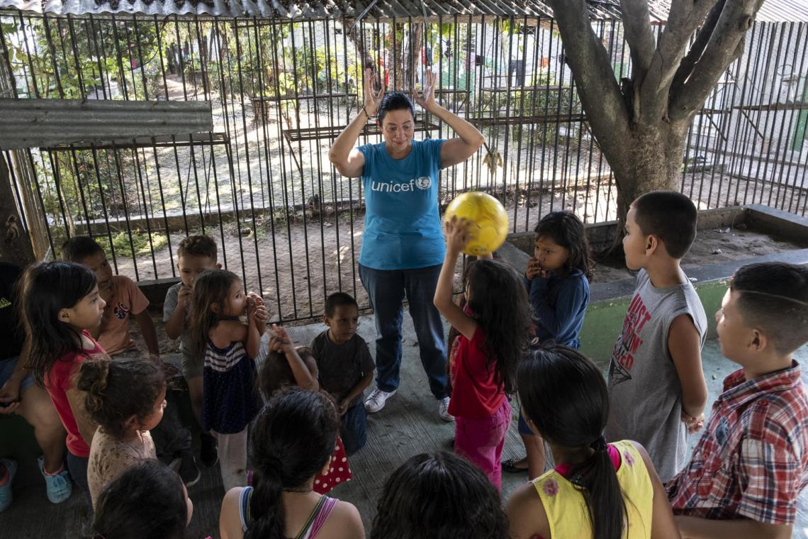 A UNICEF-supported local NGO volunteer plays with children at the St. Augustine hotel for refugees in Tapachula, Mexico. UNICEF offices in northern Central America and Mexico partner with civil society organizations, schools and outreach centres to provide children with activities and creative outlets that keep them out of harm's way.