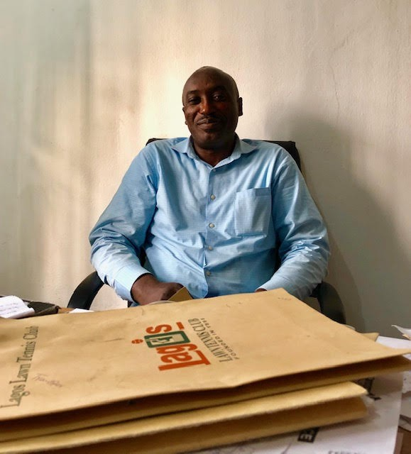 """Segun Palmer, the manager of the Lagos Lawn Tennis Club (LLTC) in Lagos, Nigeria. """"The idea of getting a scholarship and playing in college doesn't exist here. You get a sponsorship and go pro or it's nothing."""""""
