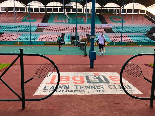 The Centre Court of the Lagos Lawn Tennis Club (LLTC) in Lagos, Nigeria. Once a premier spot for pro tennis luminaries, such as Arthur Ashe and Stan Smith, the club now hosts regional ITF tournaments and many games of scratch tennis.