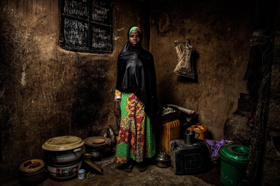 "Four years ago, violent militias attacked Banki, Nigeria, the village where Bintu Mohammed, 13, lives. ""I was in school in the morning and then I went home and… we ran, everyone ran,"" she says. ""They burned the school down. I was so upset, I felt like my dreams would never be achieved."" After returning from two years in Cameroon, Bintu enrolled in a rebuilt school. ""I'm so happy to be back… I will be educated,"" Bintu says standing in her home on 1 May 2019."