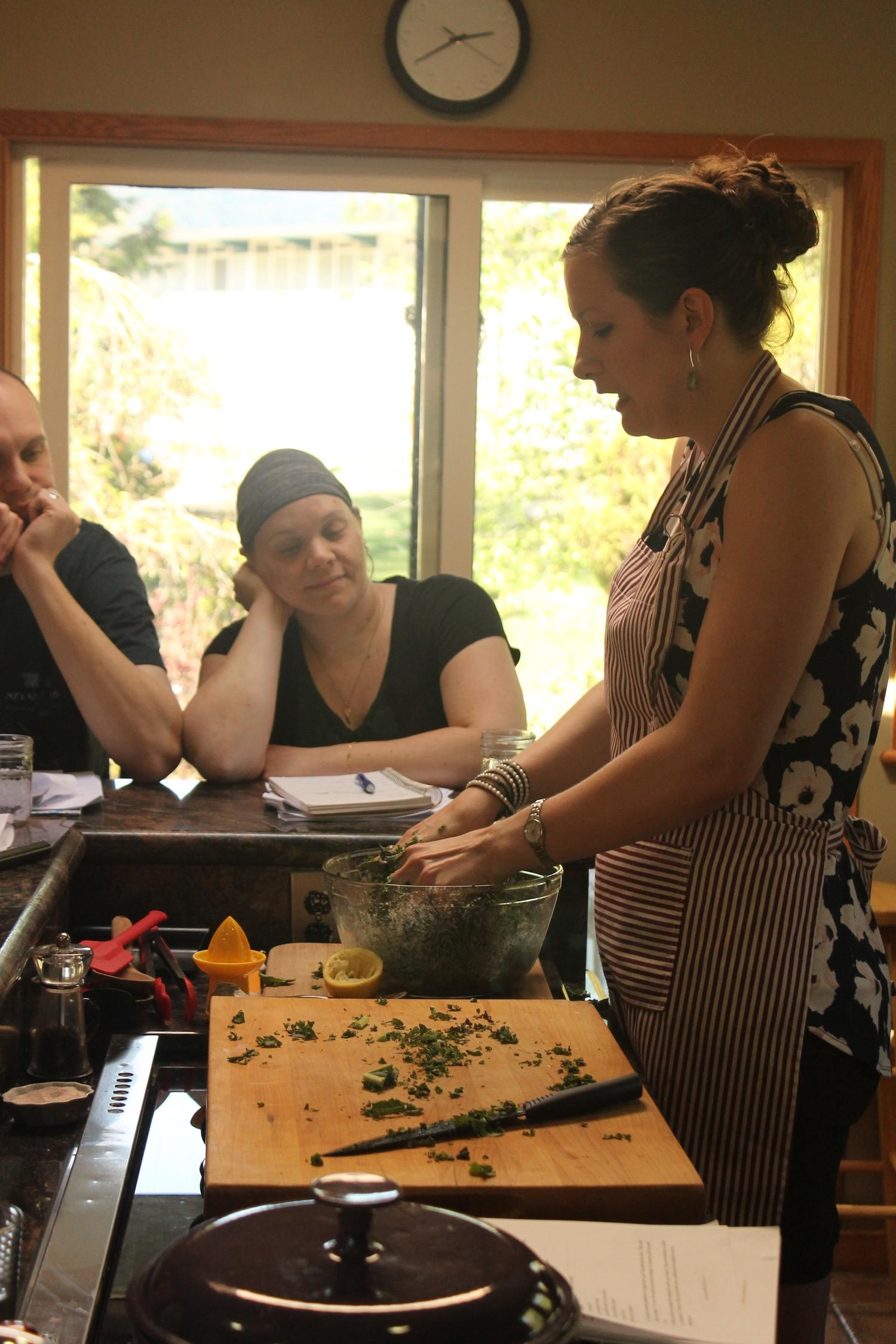 Making a marinated kale salad at the Soulful Retreat