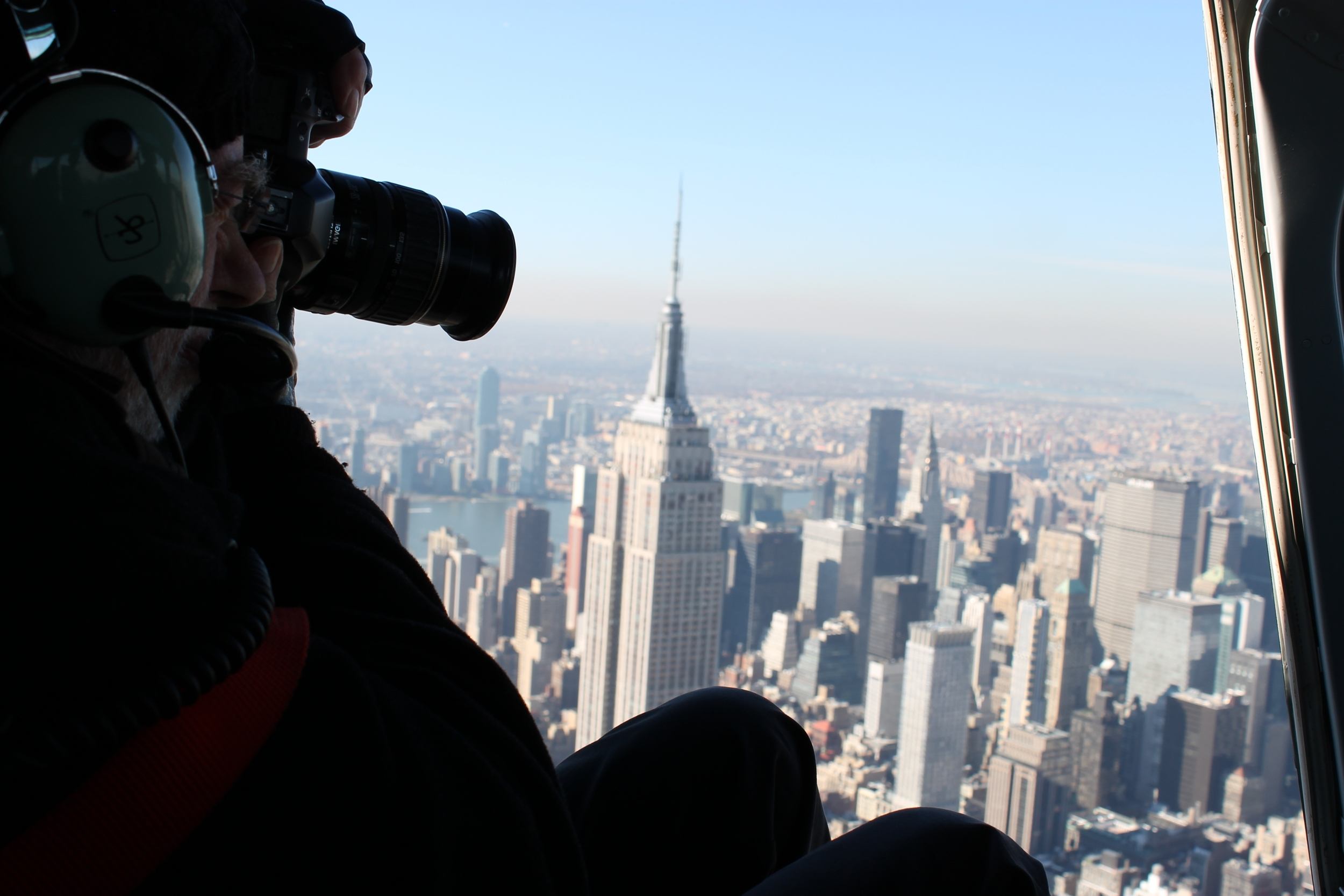 Salzmann photographing New York from a helicopter.