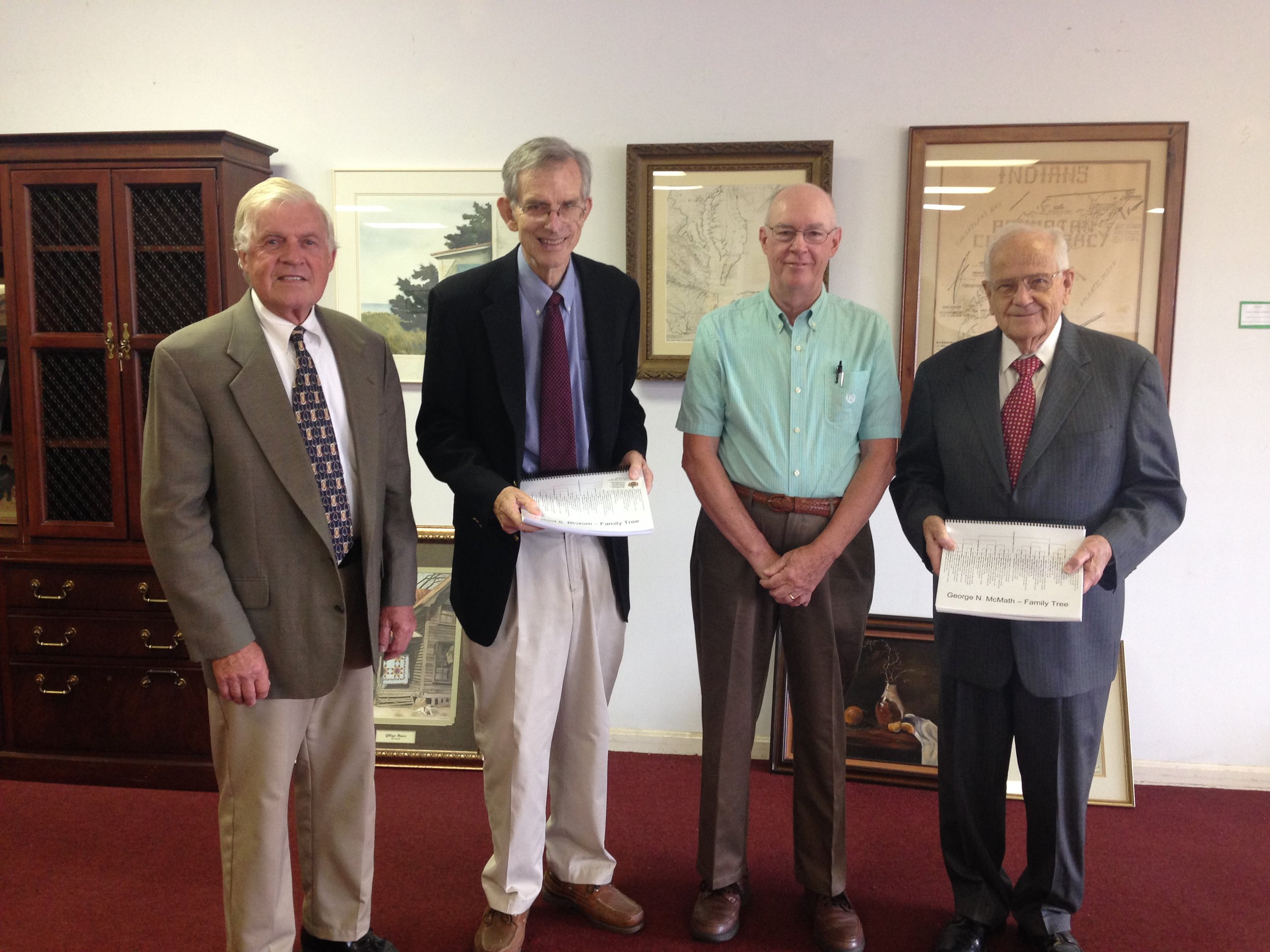 """Photo attached: Left to right: Fitz Godwin, Chairman of ESPL Foundation Capital Campaign's first phase, Honorable Bob Bloxom, M.K. """"Moody"""" Miles, and Honorable George McMath, and are pictured. Miles presented Bloxom and McMath with their family history in appreciation for their support of the first regional library."""