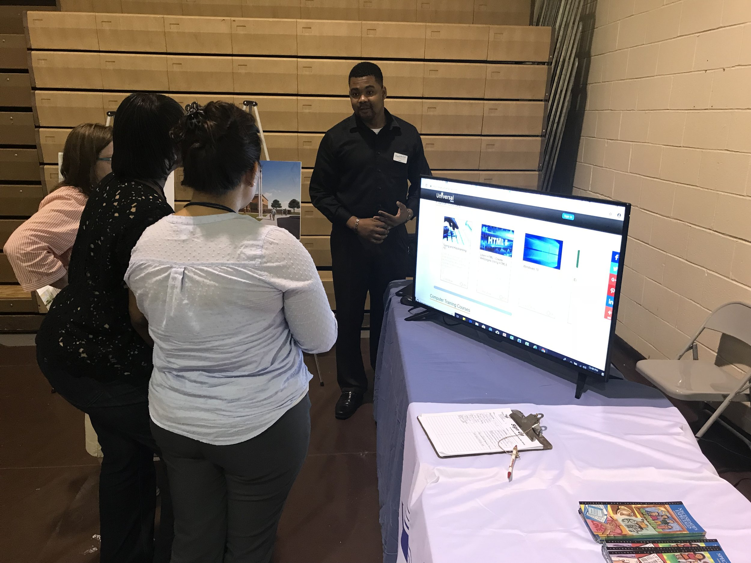 Photo: Wells Gregoire, Adult Services Specialist for Eastern Shore Public Library, demonstrates career resources on FindItVirginia at the recent Disabilities Awareness event.